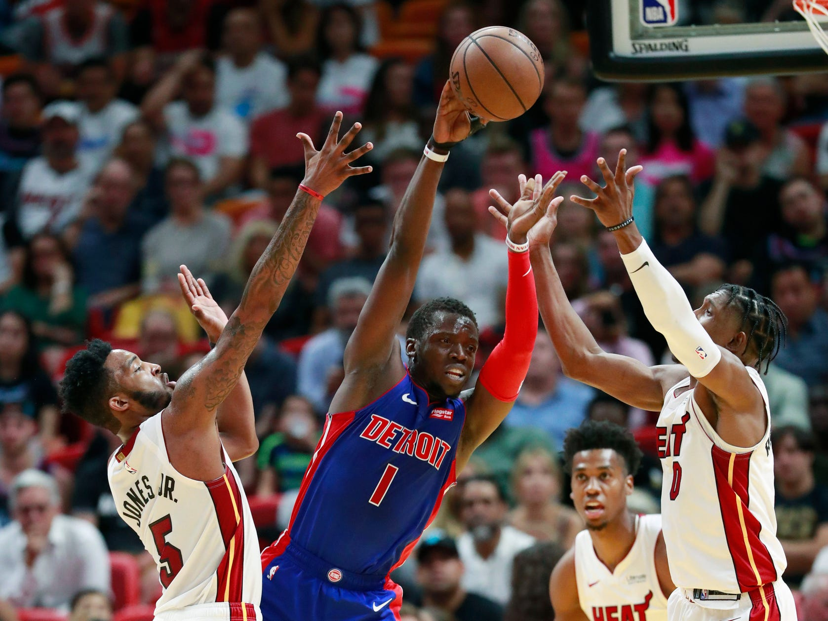 Detroit Pistons guard Reggie Jackson (1) passes past Miami Heat forward Derrick Jones Jr. (5), center Hassan Whiteside (21) and guard Josh Richardson (0) during the second half.