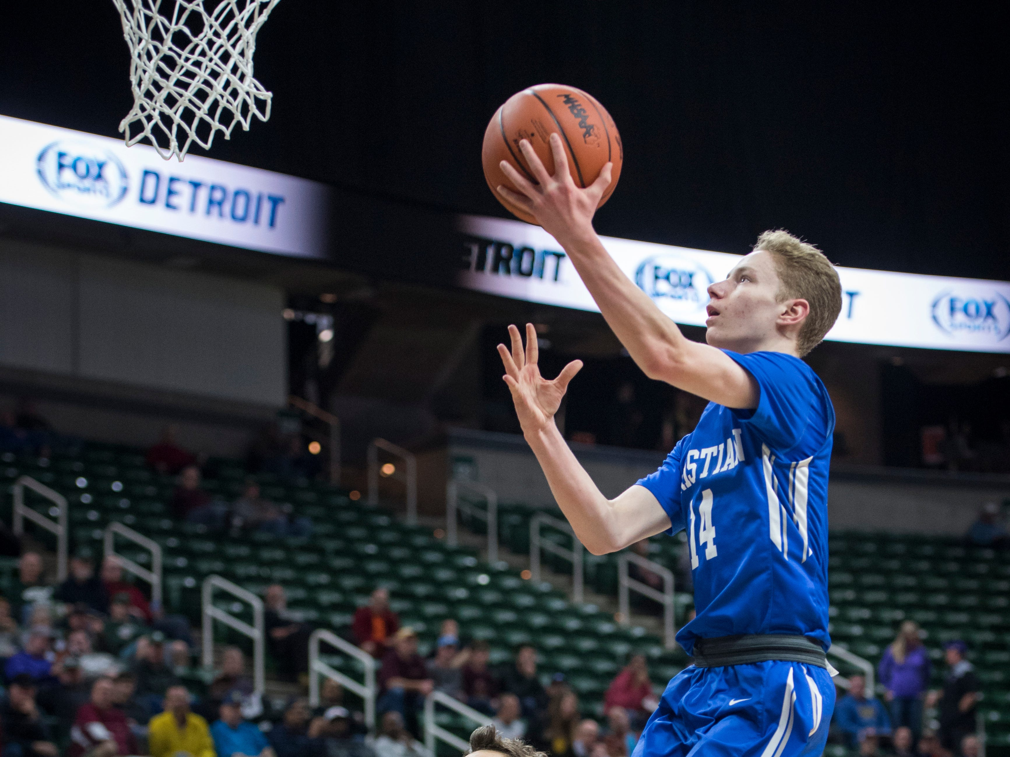 Southfield Christian's Noah Rheker shoots a layup in the second half. '