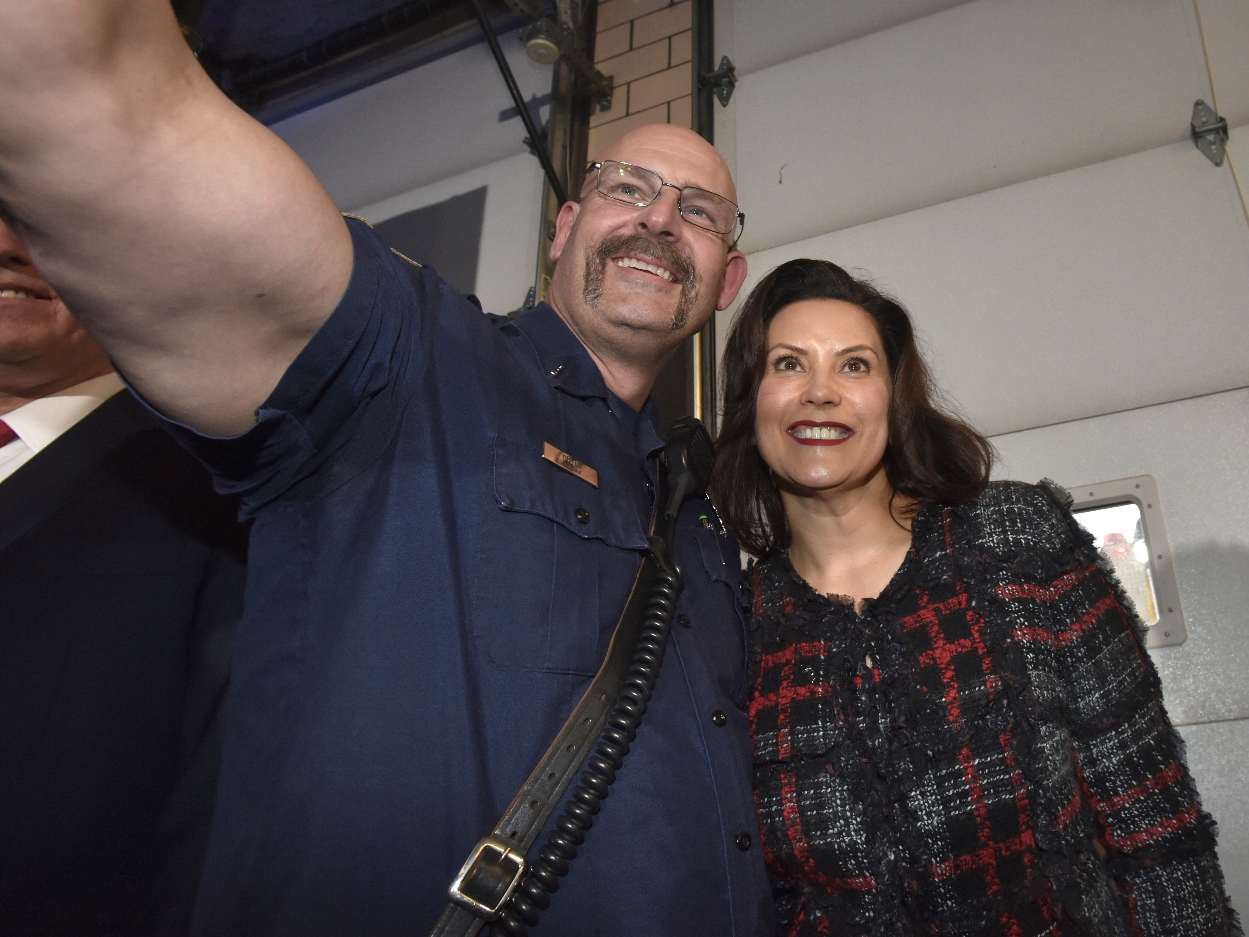 Eastpointe Fire Lt. Kirk Lee, left, takes a selfie with Michigan Governor Gretchen Whitmer after the press conference.
