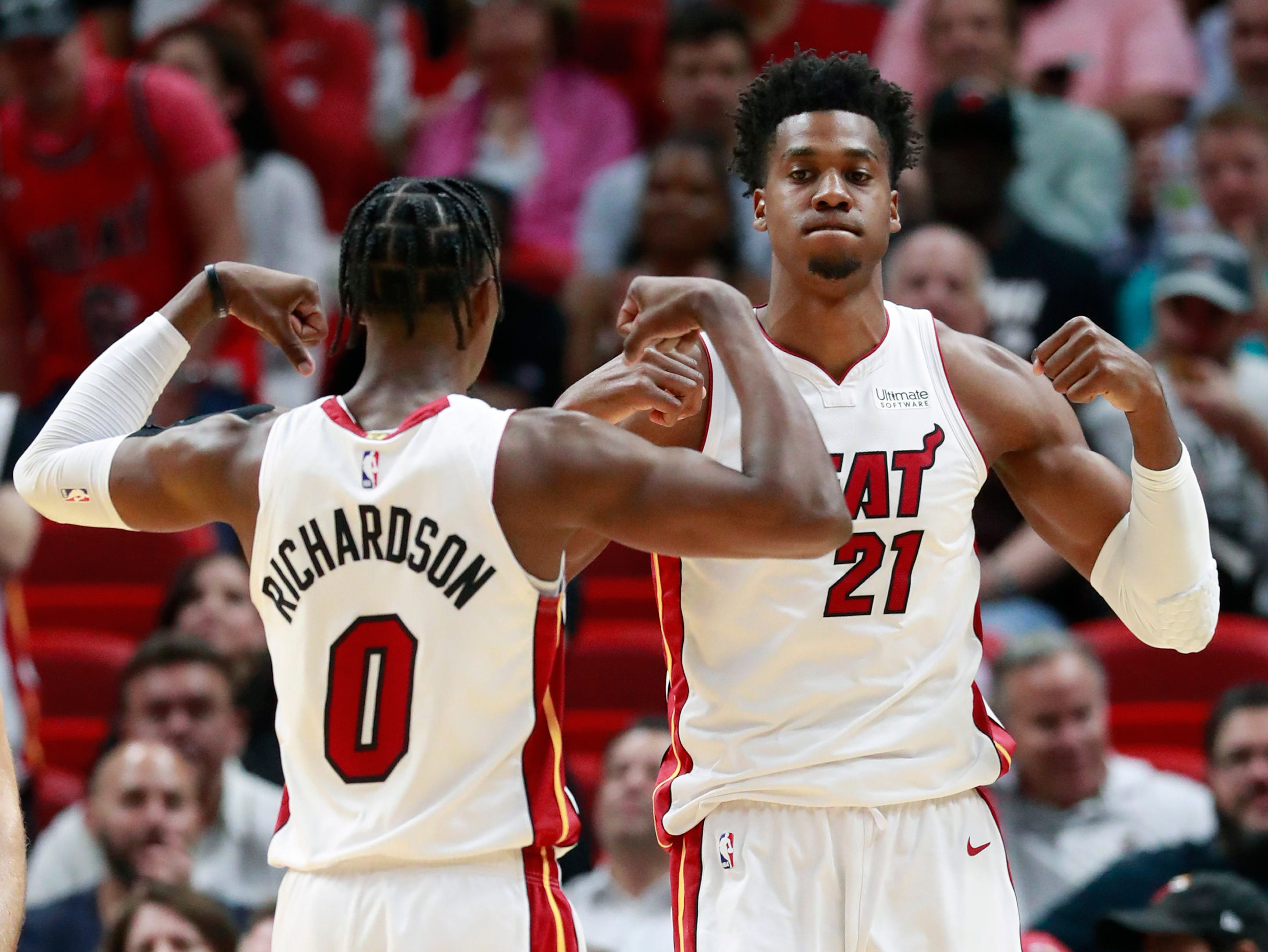 Miami Heat center Hassan Whiteside (21) and guard Josh Richardson (0) celebrate after Whiteside scored during the first half.