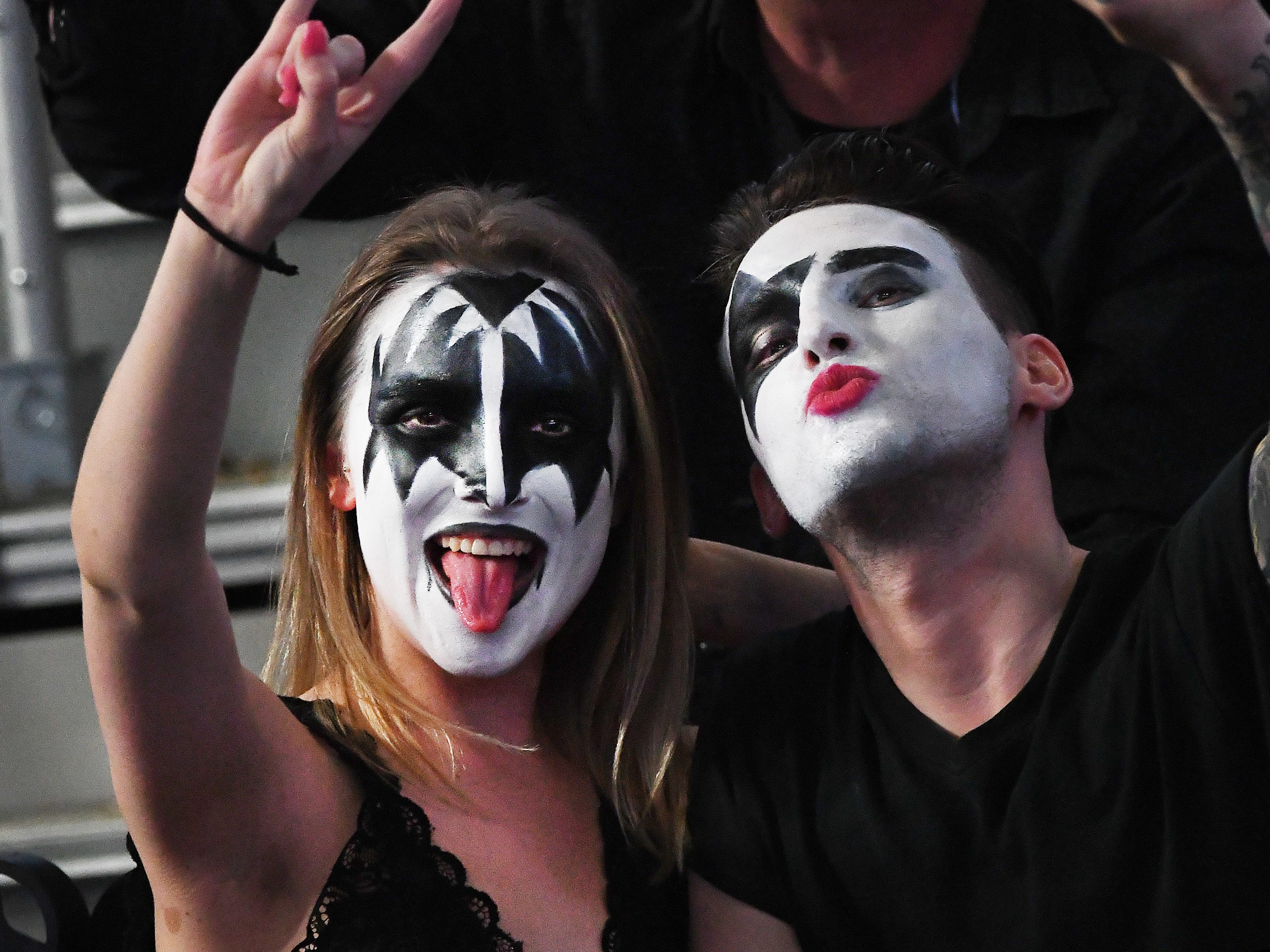 KISS fans wear their best makeup of their favorite members of the band, waiting for the start of the concert.