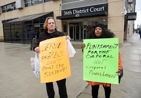 Scotty Boman of Detroit and  Marilyn Jordan of Detroit protest Detroit Police Corporal Dwayne Jones in front of 36th District Court Thursday morning.