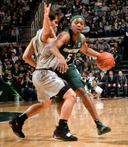 Michigan State point guard Cassius Winston is ranked No. 9 among Sports Illustrated's top 50 college baketball players for 2018-19.
