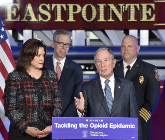 Former City of New York Mayor Michael Bloomberg, center, answers a reporter's question Thursday as Michigan Gov. Gretchen Whitmer, Robert Gordon of the state's Department of Health and Human Services, and Eastpointe Deputy Fire Chief Nick Sage join Bloomberg at the Eastpointe Fire Department to announce Bloomberg Philanthropies has committed $10 million to help Michigan tackle the opioid crisis.