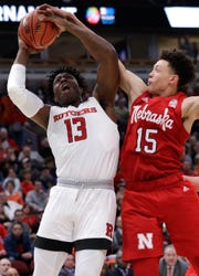 Nebraska forward Isaiah Roby blocks a shot by Rutgers forward Shaq Carter during the second half.