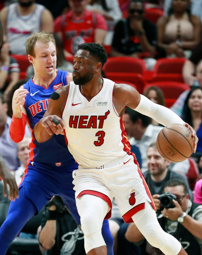 Miami Heat guard Dwyane Wade (3) drives against Detroit Pistons guard Luke Kennard during the first half on Wednesday, March 13, 2019, in Miami, Florida.