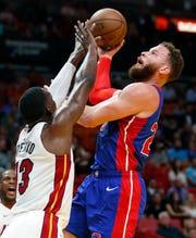 Detroit Pistons forward Blake Griffin shoots against Miami Heat center Bam Adebayo during the first half.