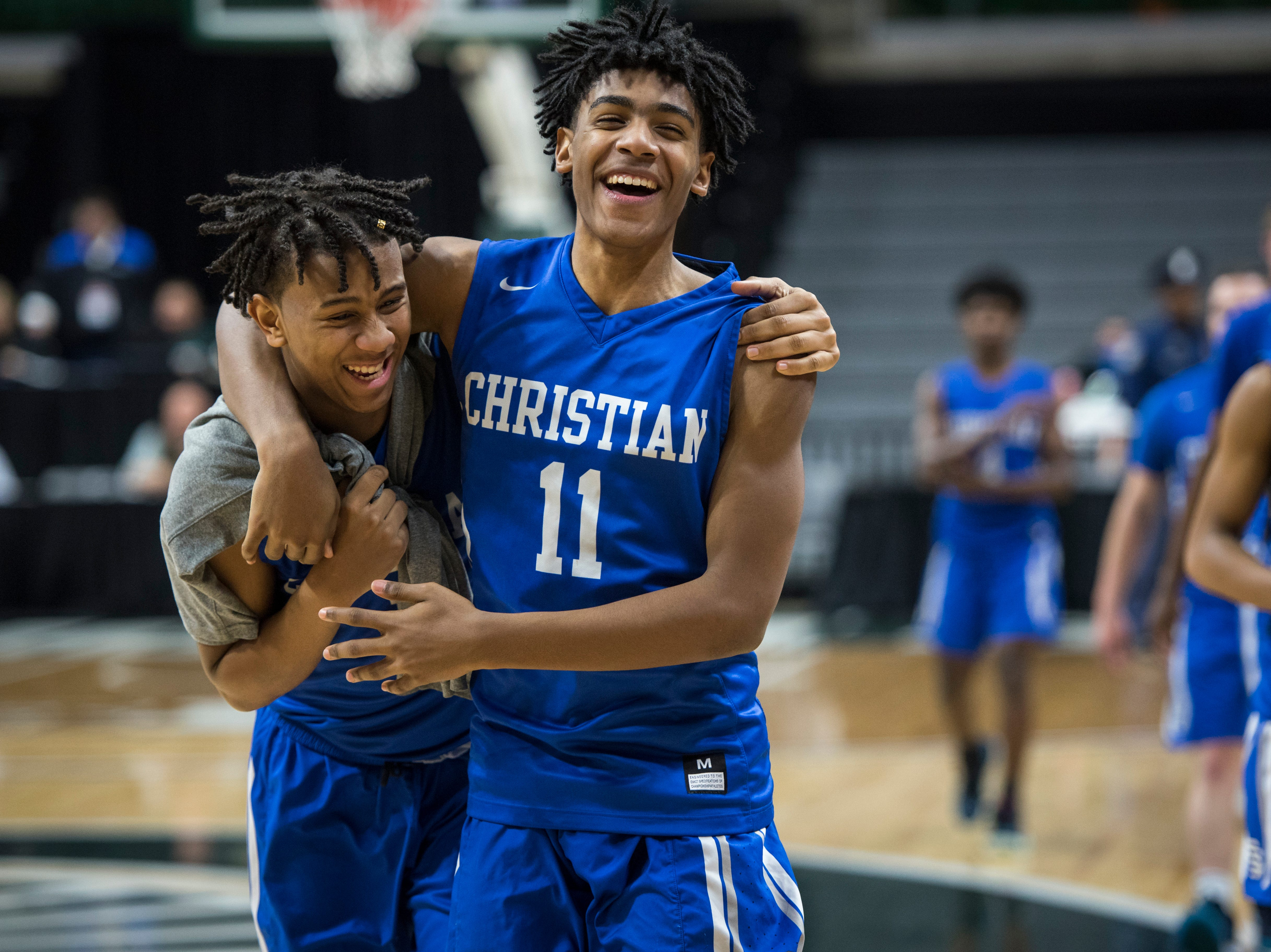 Southfield Christian's Tarron Carter, left, and Southfield Christian's Malcolm King celebrate their win after the game.