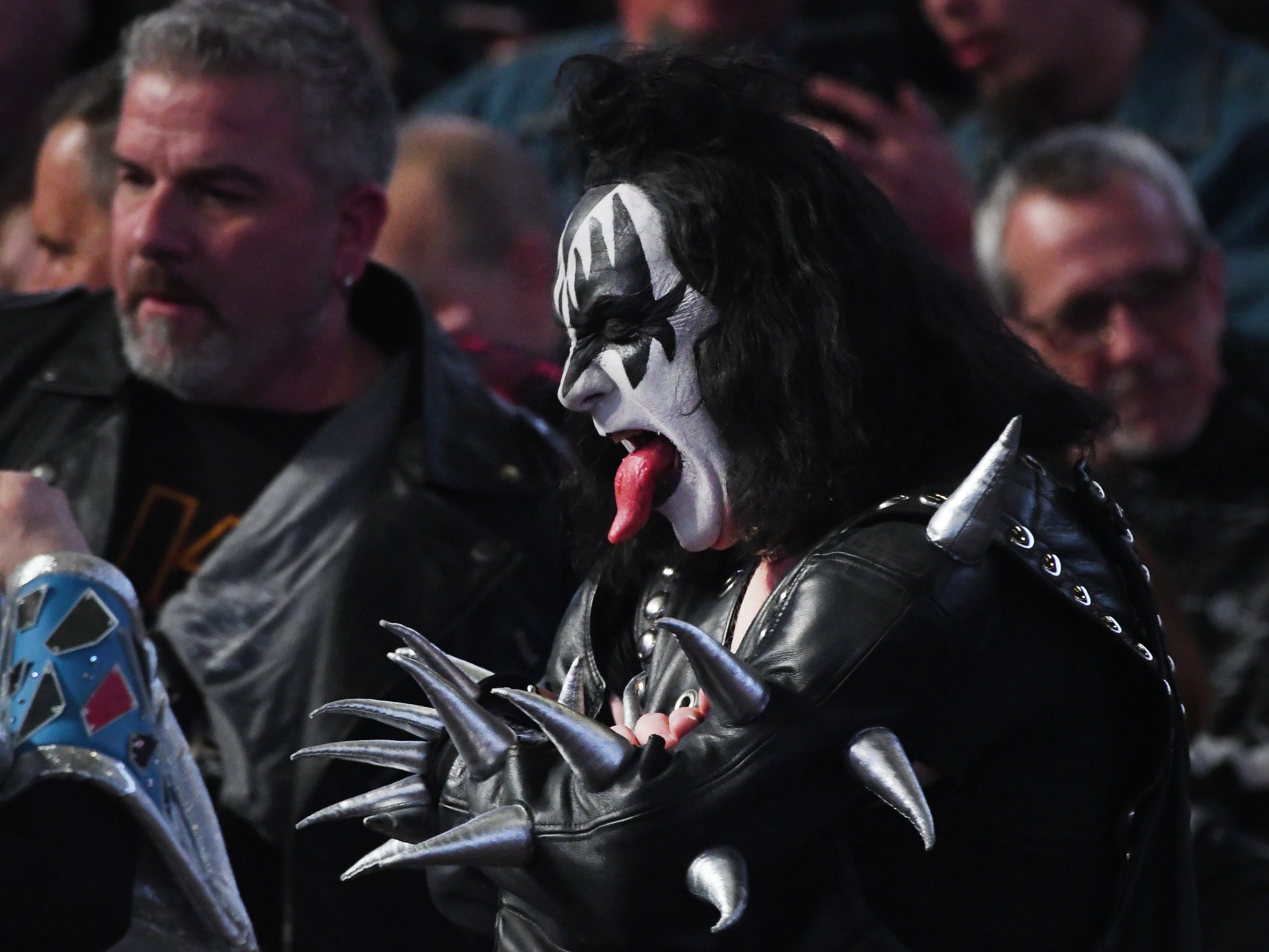 Gene Simmons would be so proud as a KISS fan shows his makeup, outfit and rather extensive tongue waiting for the concert to begin.