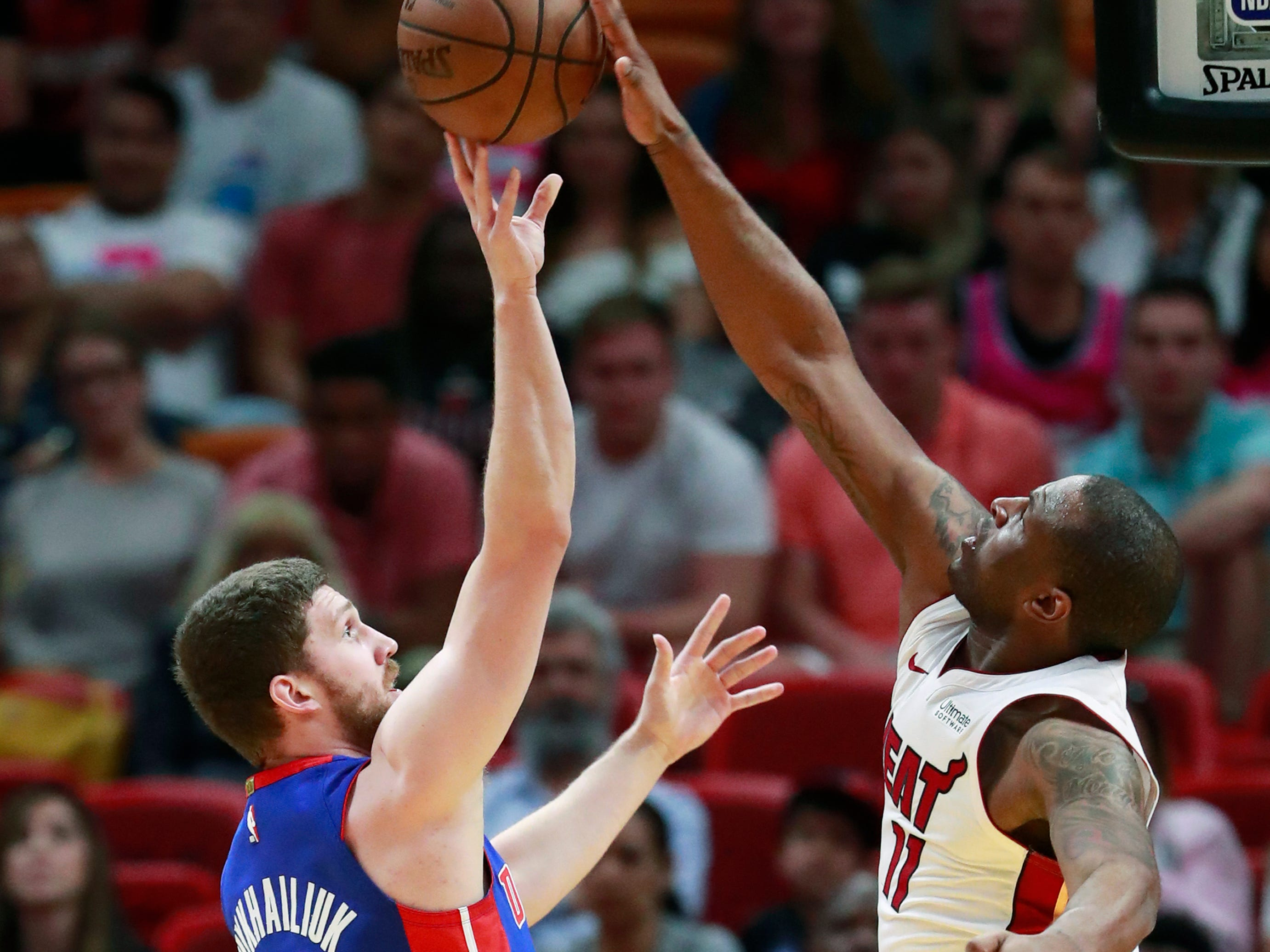 Miami Heat guard Dion Waiters (11) swats a shot away from Detroit Pistons guard Sviatoslav Mykhailiuk (19) during the second half.