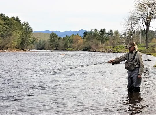 Gary Romanic, of Vestal, casts a fly rod on the West Branch of the Ausable River in the Adirondacks.