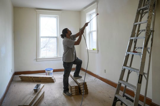 Eli Clay of Bellomy Interiors paints the walls of a future one bedroom apartment inside the historic Rathbone building located near Haynie's Corner in Evansville, Ind., Wednesday, March 13, 2019. According to part-owner Shannon Huffer, there are a handful of two-bedroom apartments that will be ready to lease within the next week.