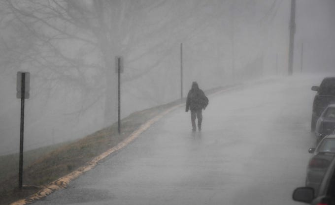 Walking in a down pour, Keith Johnson makes his way home along Dreier Boulevard in Evansville as a series of storms brought multiple sever storm and tornado warning to the area Thursday, March 14, 2019.