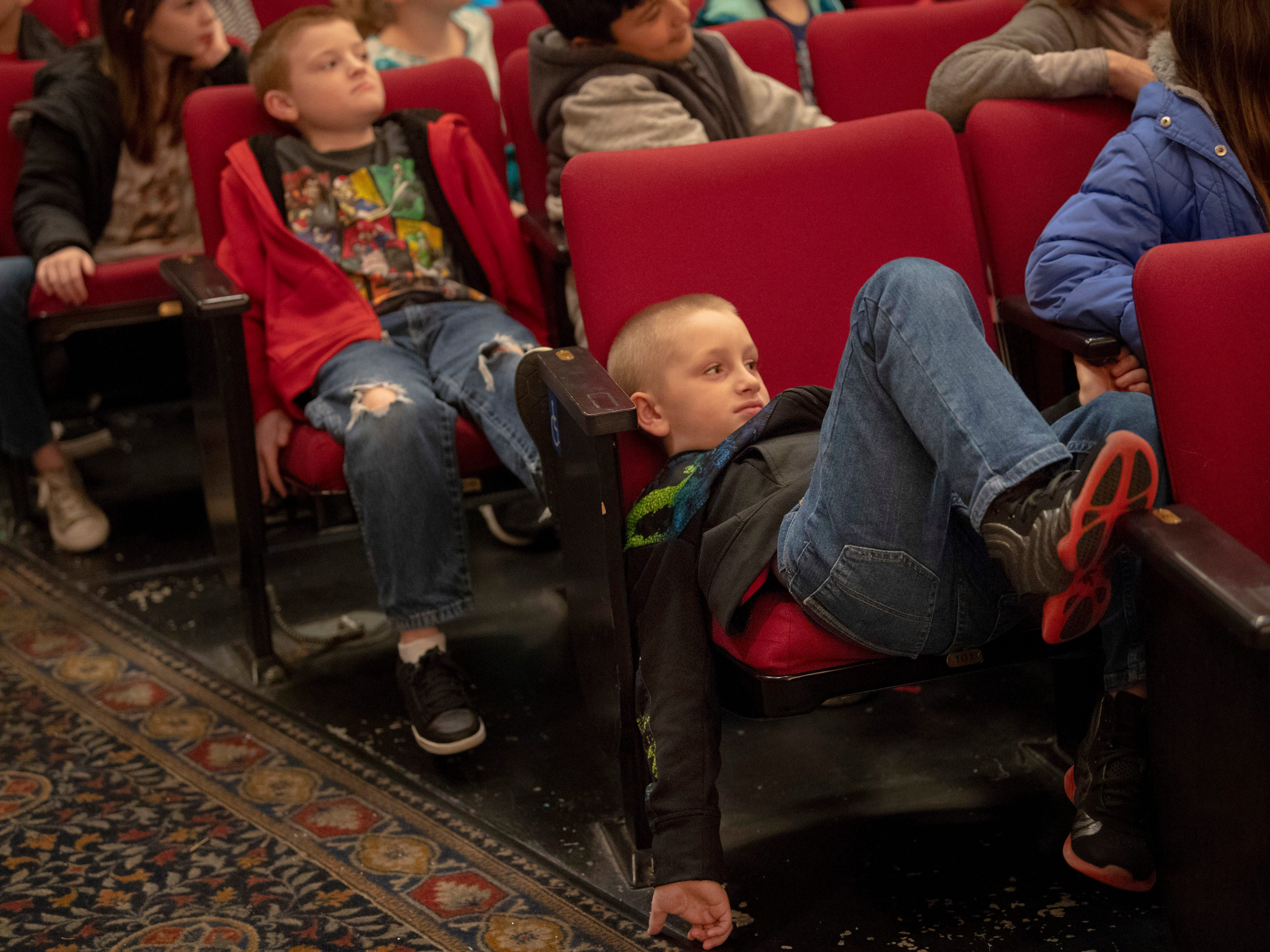 Michael Vailes, 9, a Highland Elementary School student, takes in the Young People's Concerts performed by the Evansville Philharmonic Orchestra at The Victory Thursday morning. The kids were attending the first concert when a series of tornado warnings necessitated the students take shelter in the building's basement and auditorium.