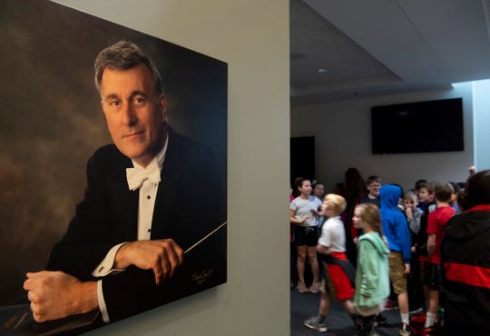 Maestro Alfred Savia's portrait welcomes area elementary school students to the Young People's Concerts performed by the Evansville Philharmonic Orchestra at The Victory Thursday morning.