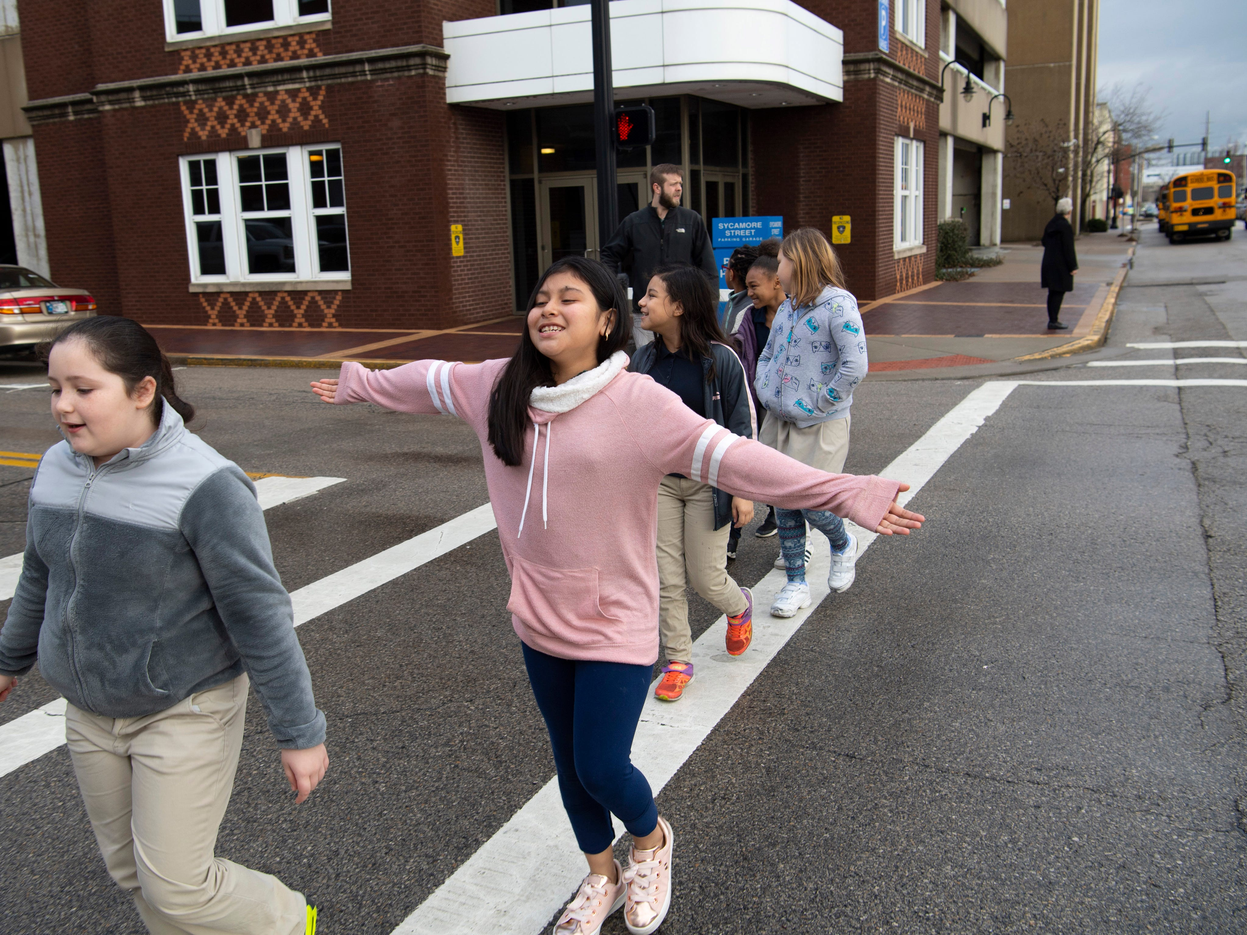Jenifer Perez, a 4th grade student at Stockwell Elementary School, second left, heads into the Young People's Concerts where the Evansville Philharmonic Orchestra was going to play at The Victory Thursday morning.