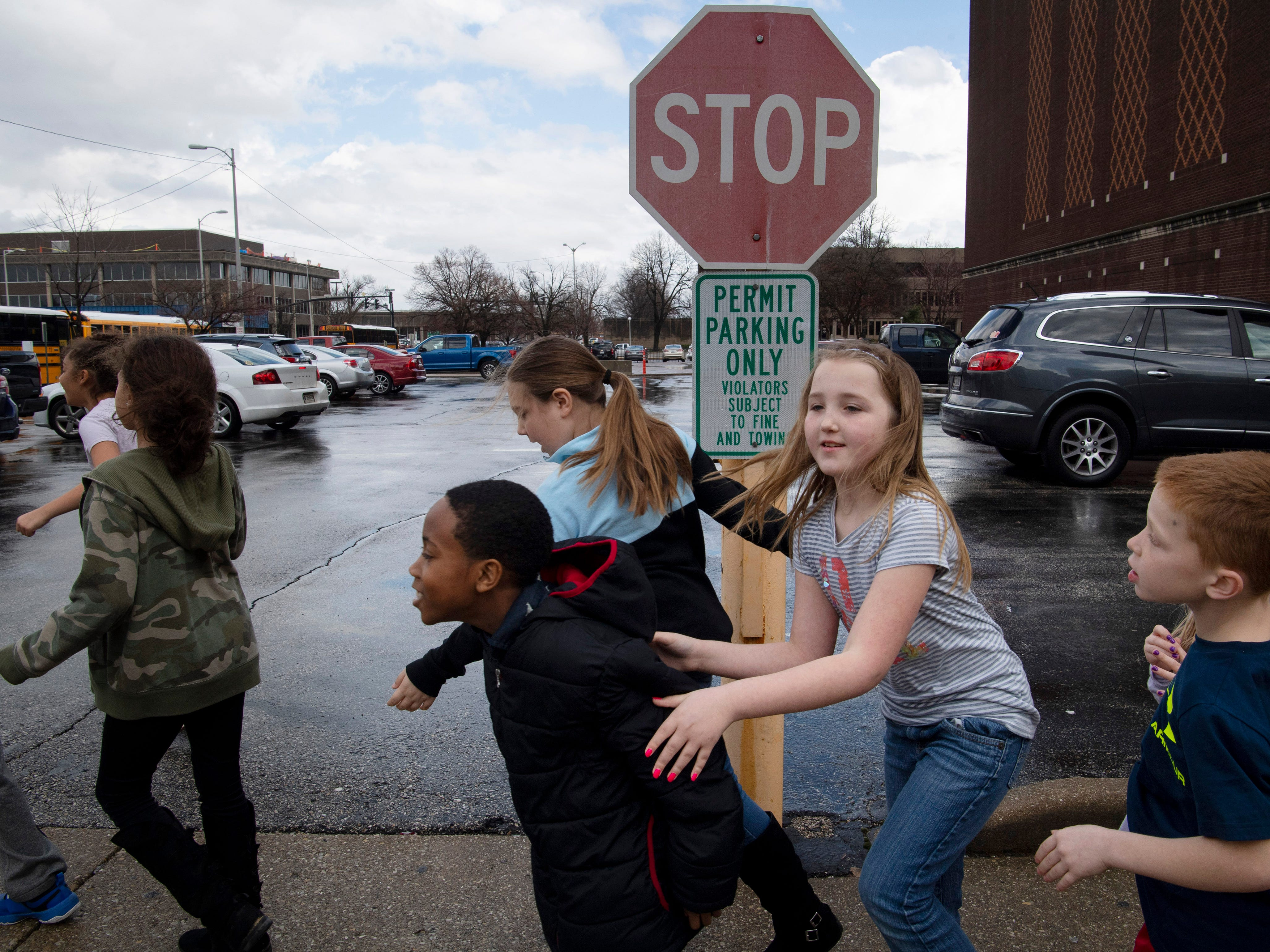 Elementary school students head for their buses after being allowed to leave The Victory Thursday afternoon. The kids were attending the Young People's Concerts performed by the Evansville Philharmonic Orchestra when a series of tornado warnings necessitated the students take shelter in the building's basement and auditorium.