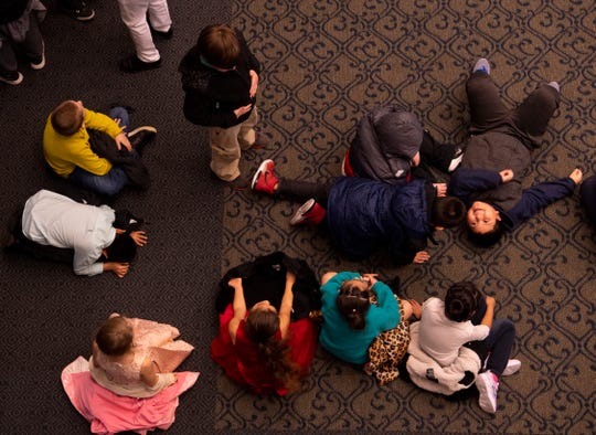 Students from Lena Dunn Elementary School in Washington, Ind., wait out the last tornado warning of the morning at the Young People's Concerts at The Victory Thursday morning. The Evansville Philharmonic Orchestra made it through the first show of the day before a series of tornado warnings necessitated the sheltering of the kids in the basement, dressing rooms and auditorium.