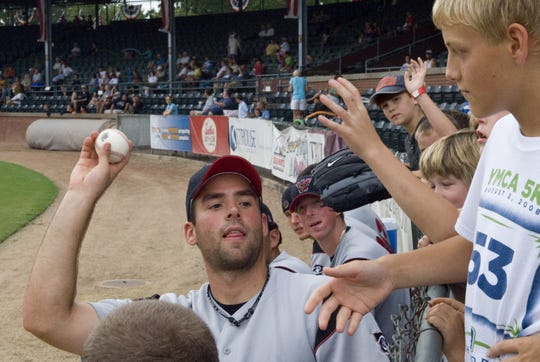 Washington Wild Things' Sam Mann (21) throws a second fall ball far to the audiences during the seventh inning after the kids near by received the first fall ball at Bosse field during the game against Evansville Otters on  Aug. 24, 2008.