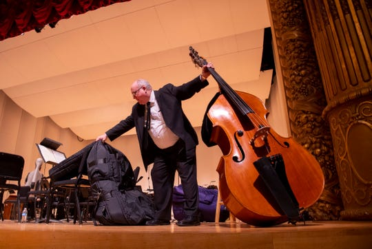Principal bass player Greg Olson of Owensboro, Ky., packs up his instrument after being given the go-ahead to go home after the Young People's Concerts at The Victory Thursday morning. Olson, the Evansville Philharmonic Orchestra and more than 1,000 area elementary school children were forced to take cover in the theater when a series of tornado warnings were issued.
