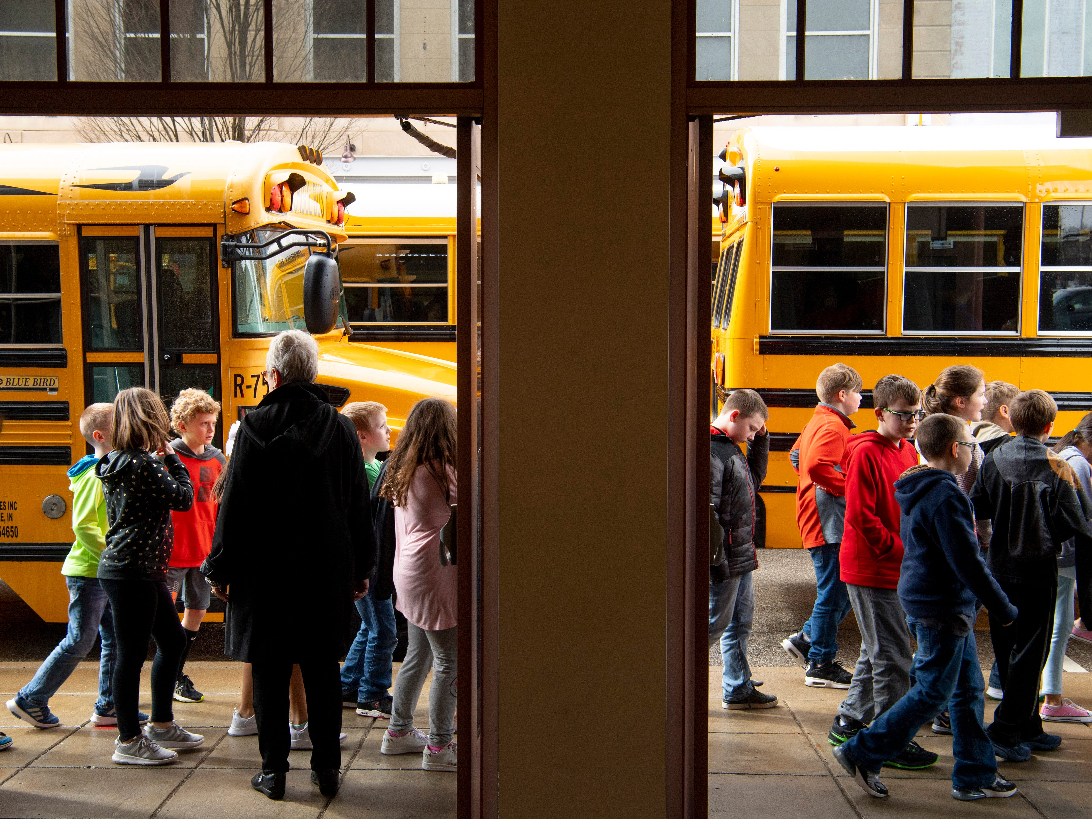 Area elementary school students head for their buses after spending the last 3 1/2 hours at The Victory Thursday afternoon. The kids arrived for the 9 a.m. performance of the Young People's Concerts performed by the Evansville Philharmonic Orchestra. A series of tornado warnings necessitated the students take shelter in the building's basement and auditorium.