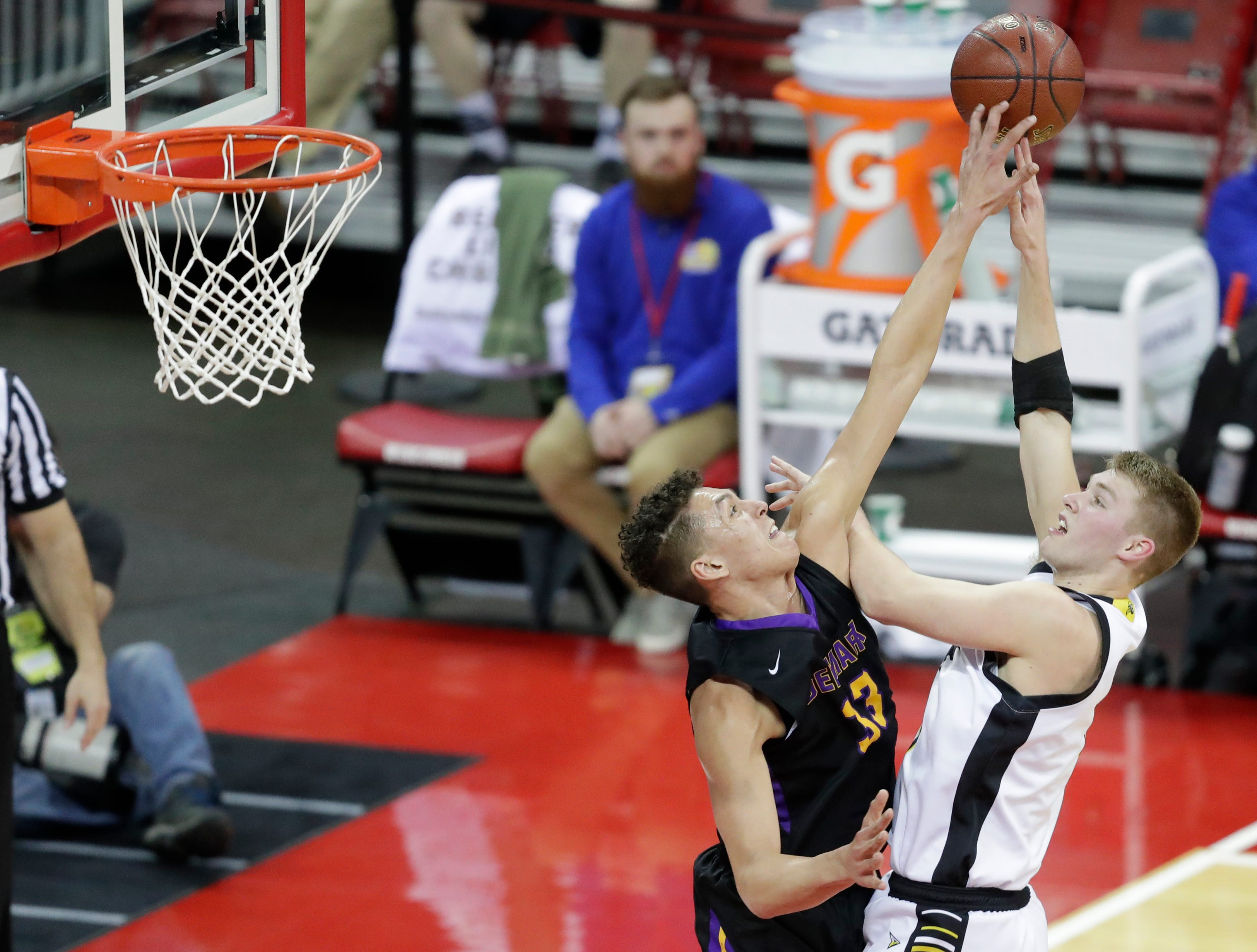 Denmark High School's Patrick Suemnick (33) blocks a shot from Waupun High School's Marcus Domask (1) during their WIAA Division 3 boys basketball state semifinal at the Kohl Center Thursday, March 14, 2019,in Madison, Wis.