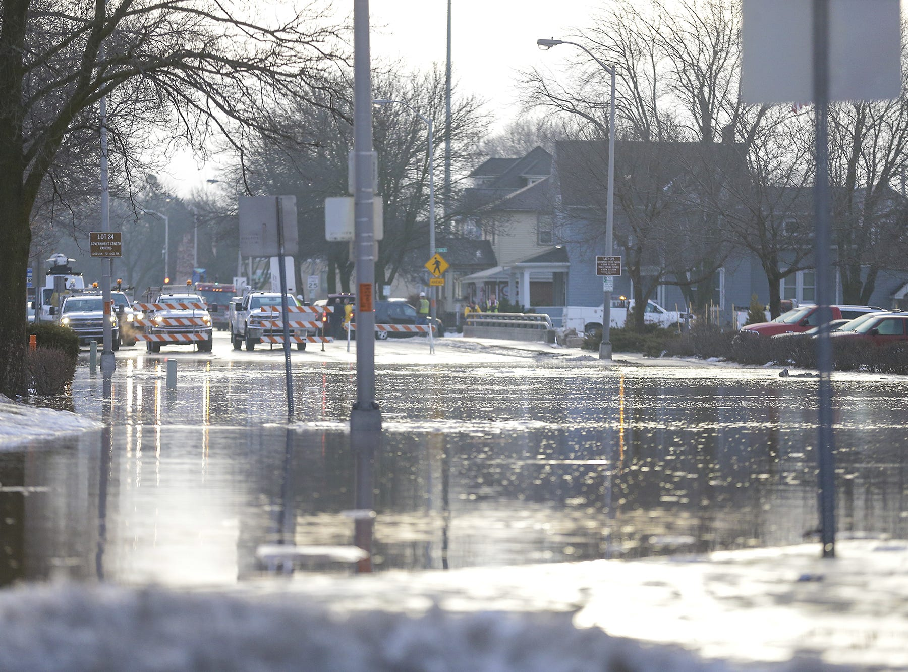 Barricades block off Western Avenue Thursday, March 14, 2019 in Fond du Lac, Wis. Ice jams on the east branch of the Fond du Lac River caused localized flooding problems in the city. Doug Raflik/USA TODAY NETWORK-Wisconsin