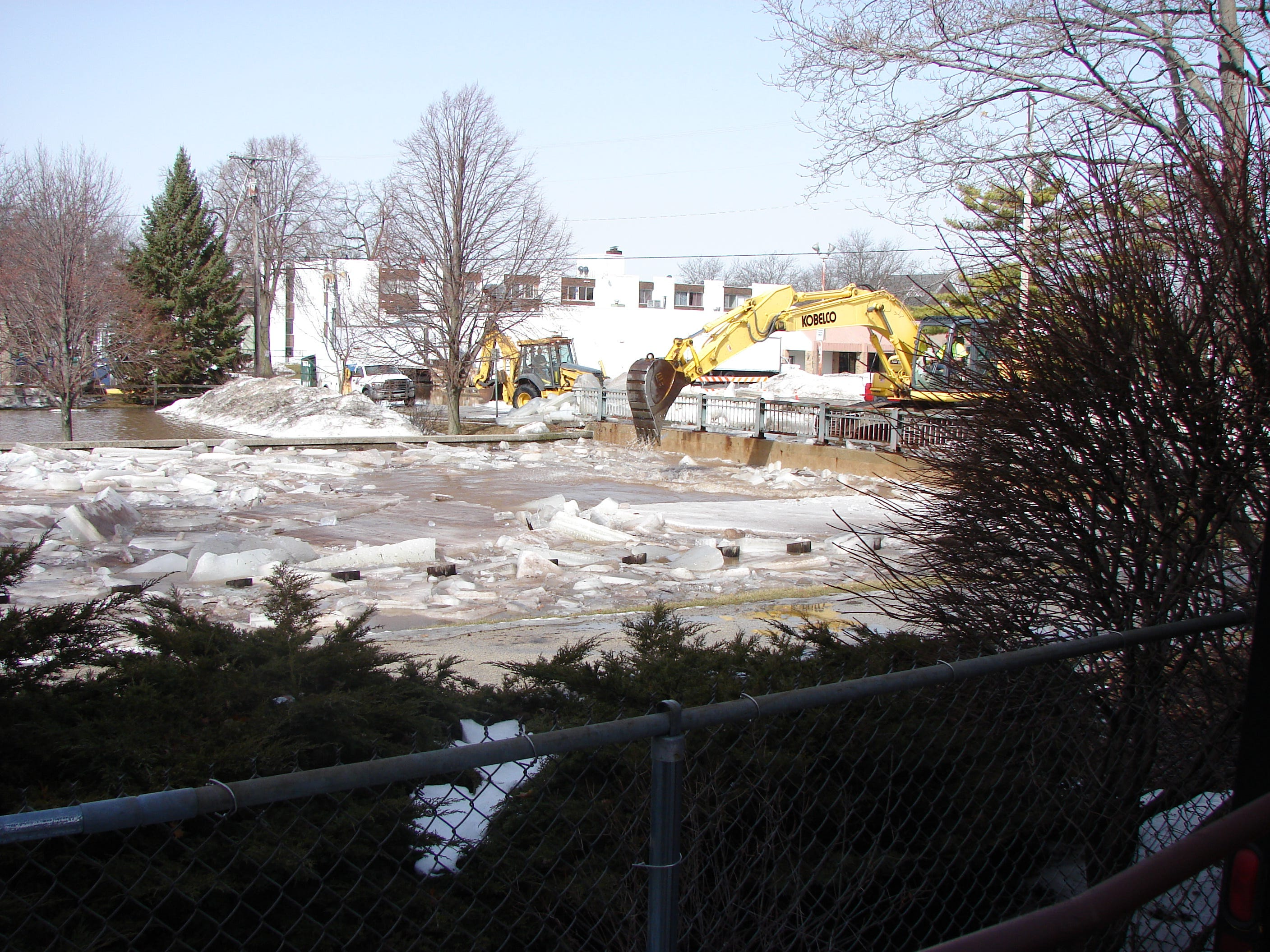 City crews set up heavy machinery Thursday on the East First Street bridge over the Fond du Lac River, in an effort to clear an ice jam.