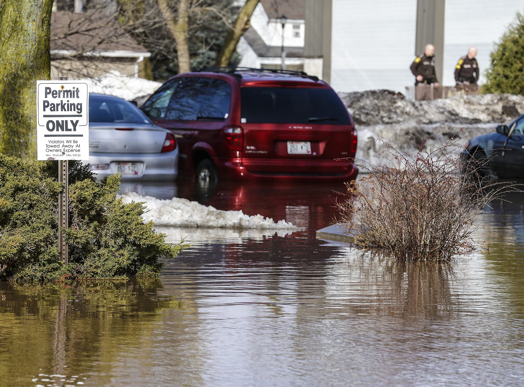 Fond du Lac County Sheriff's deputies work near a flooded parking lot Thursday, March 14, 2019 on Western Avenue in Fond du Lac, Wis. Ice jams on the east branch of the Fond du Lac River caused localized flooding problems in the city. Doug Raflik/USA TODAY NETWORK-Wisconsin