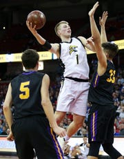 Waupun's Marcus Domask (1) puts up a shot against Denmark in a WIAA Division 3 boys basketball state semifinal Thursday at the Kohl Center in Madison.