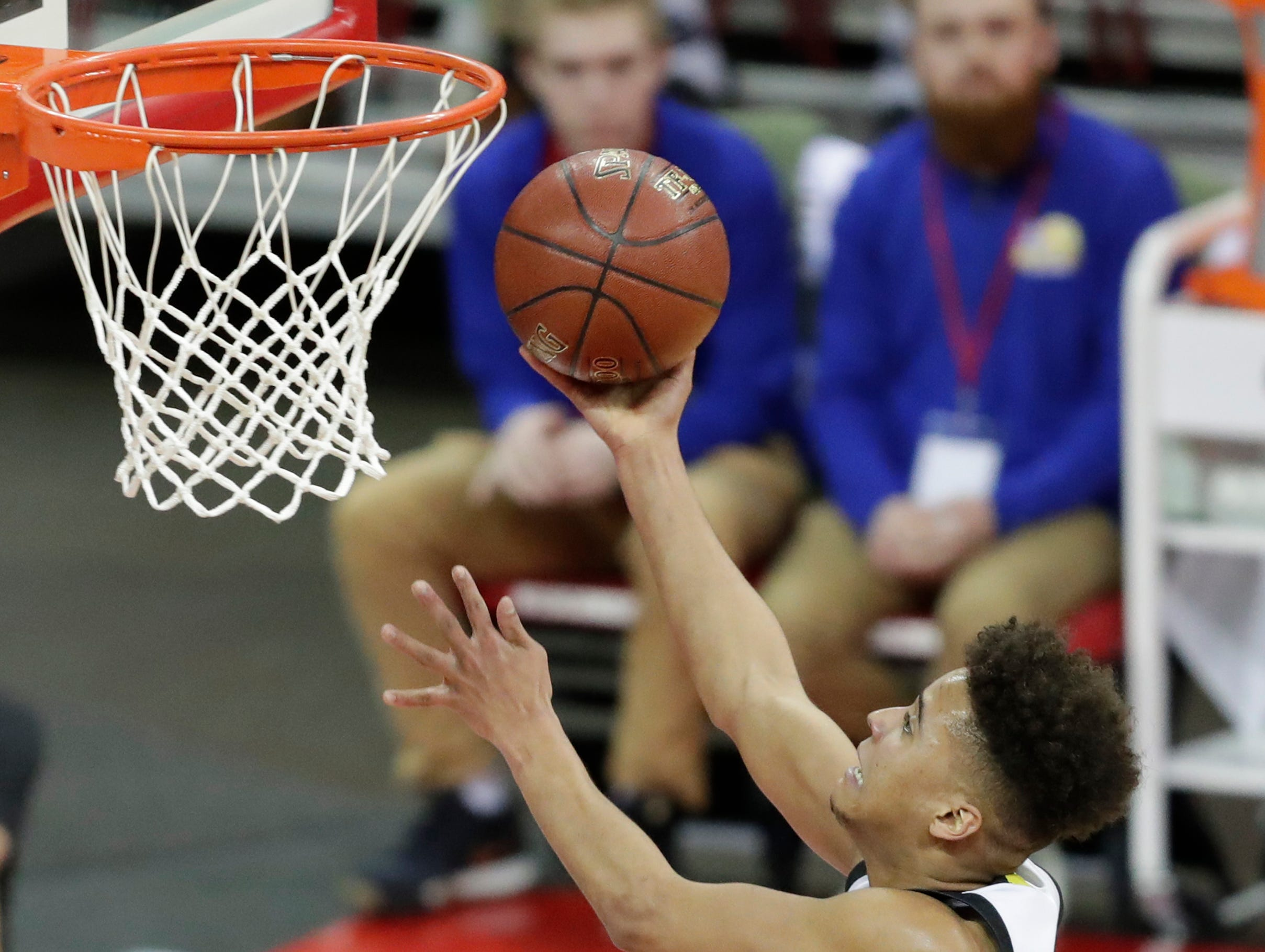 Waupun's Quintin Winterfeldt (3) shoots a layup against Denmark during their WIAA Division 3 boys basketball state semifinal at the Kohl Center Thursday, March 14, 2019, in Madison, Wis.