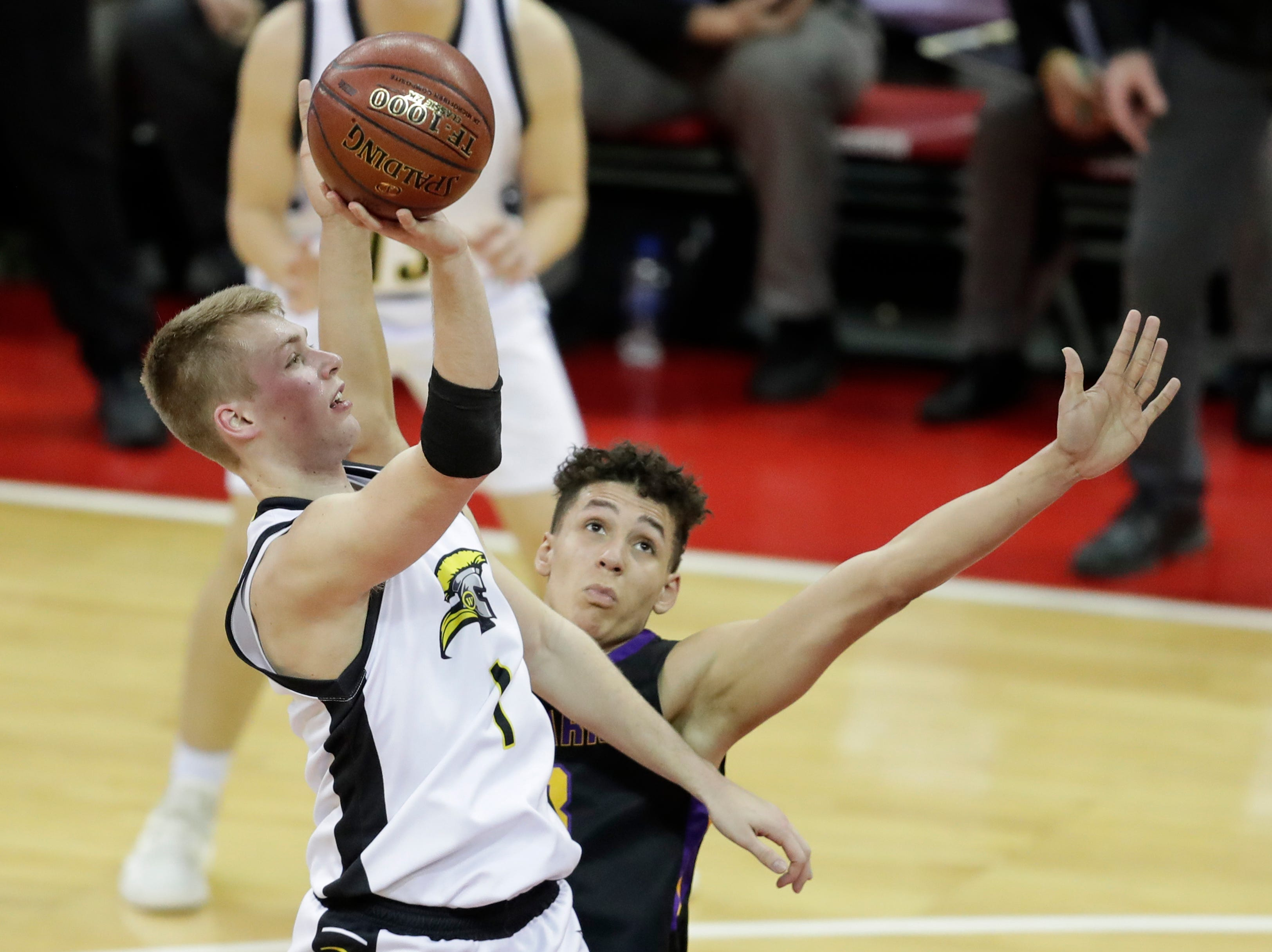 Waupun's Marcus Domask (1) shoots over Denmark's Patrick Suemnick (33) during their WIAA Division 3 boys basketball state semifinal at the Kohl Center Thursday, March 14, 2019, in Madison, Wis.