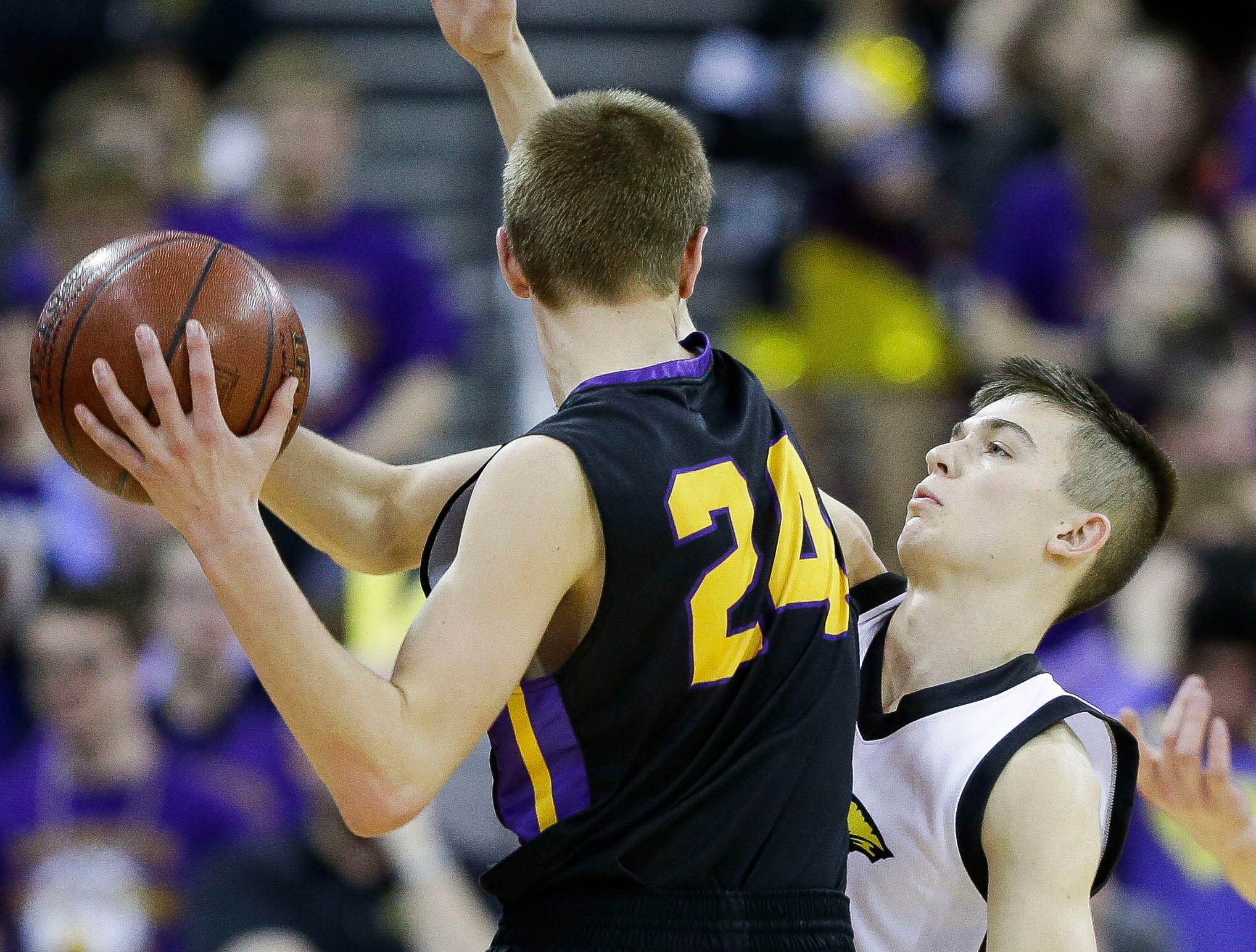 Waupun High School's Gabe Keach (21) defends Denmark High School's Zachary Gezella (24) in a Division 3 boys basketball state semifinal on Thursday, March 14, 2019, at the Kohl Center in Madison, Wis.