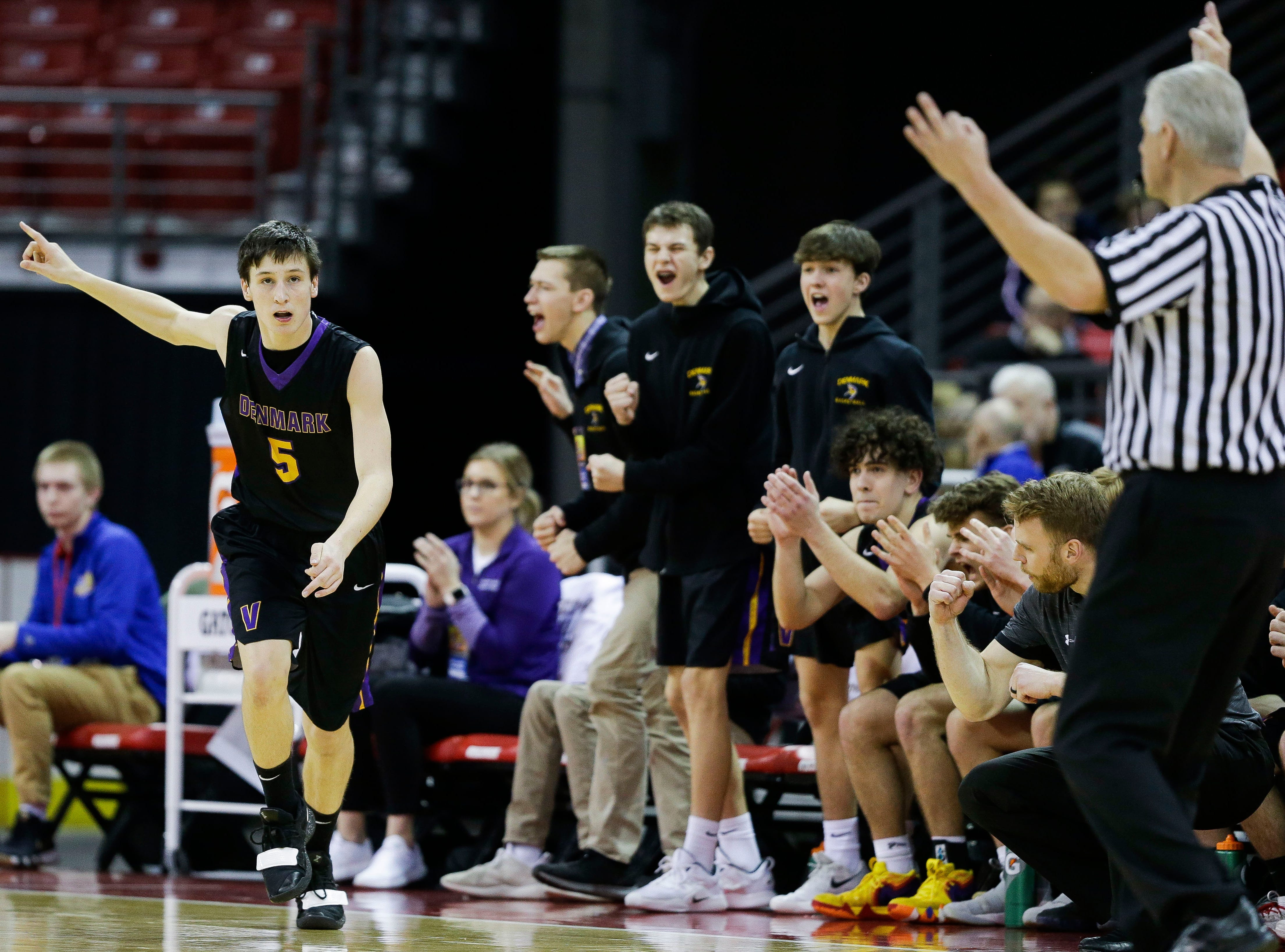 Denmark High School's Brennen Miller (5) reacts after hitting a 3-pointer against Waupun High School in a Division 3 boys basketball state semifinal on Thursday, March 14, 2019, at the Kohl Center in Madison, Wis.