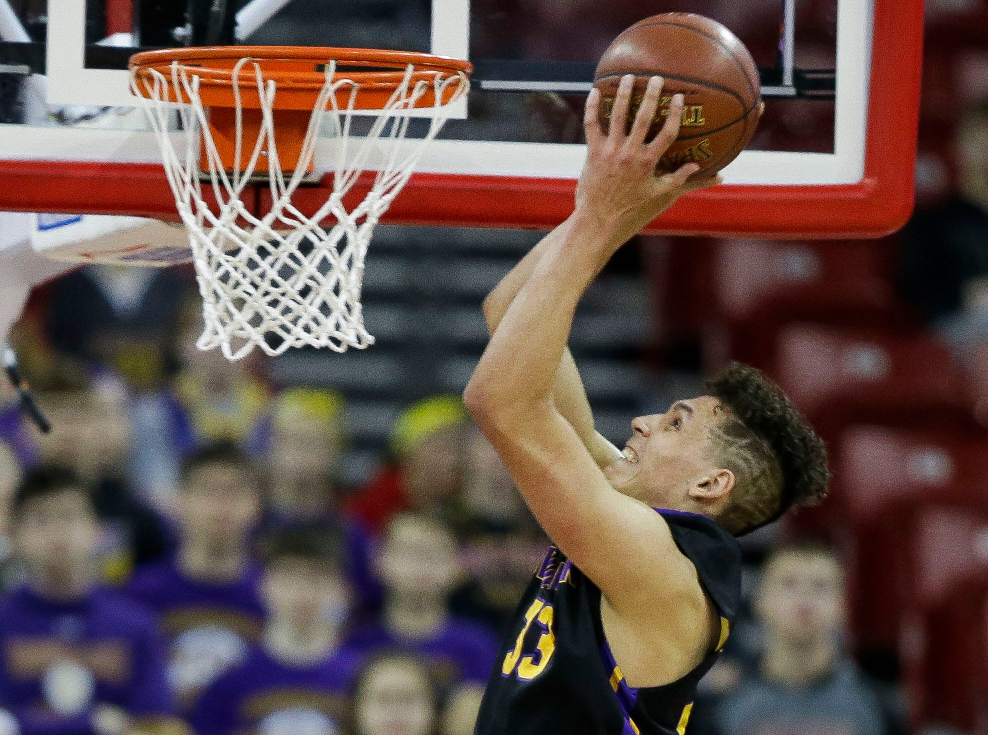 Denmark's Patrick Suemnick (33) dunks off an alley-oop against Waupun in a Division 3 boys basketball state semifinal Thursday at the Kohl Center in Madison.