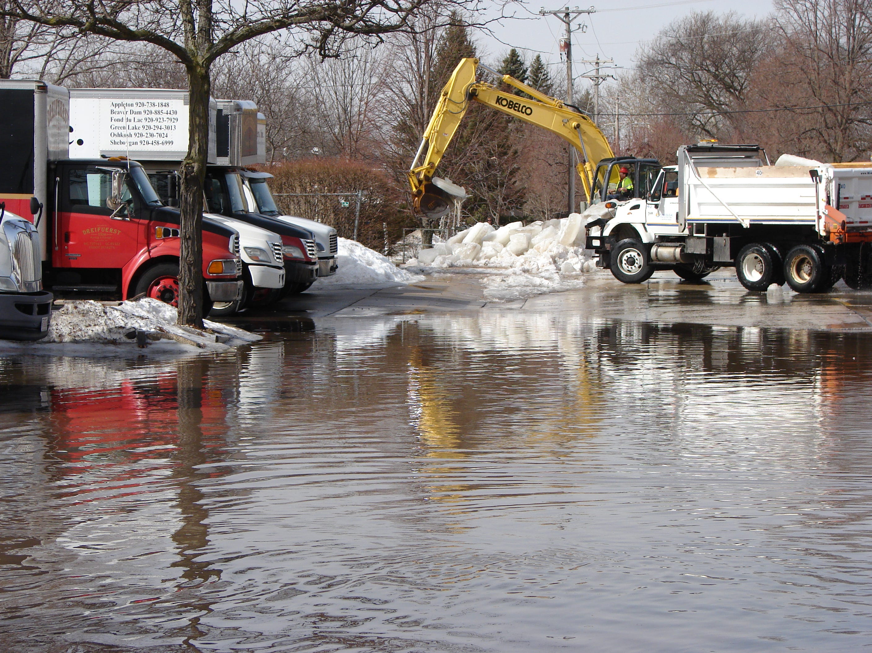 Parts of West First Street were flooded Thursday morning as crews removed an ice jam from the Fond du Lac River.