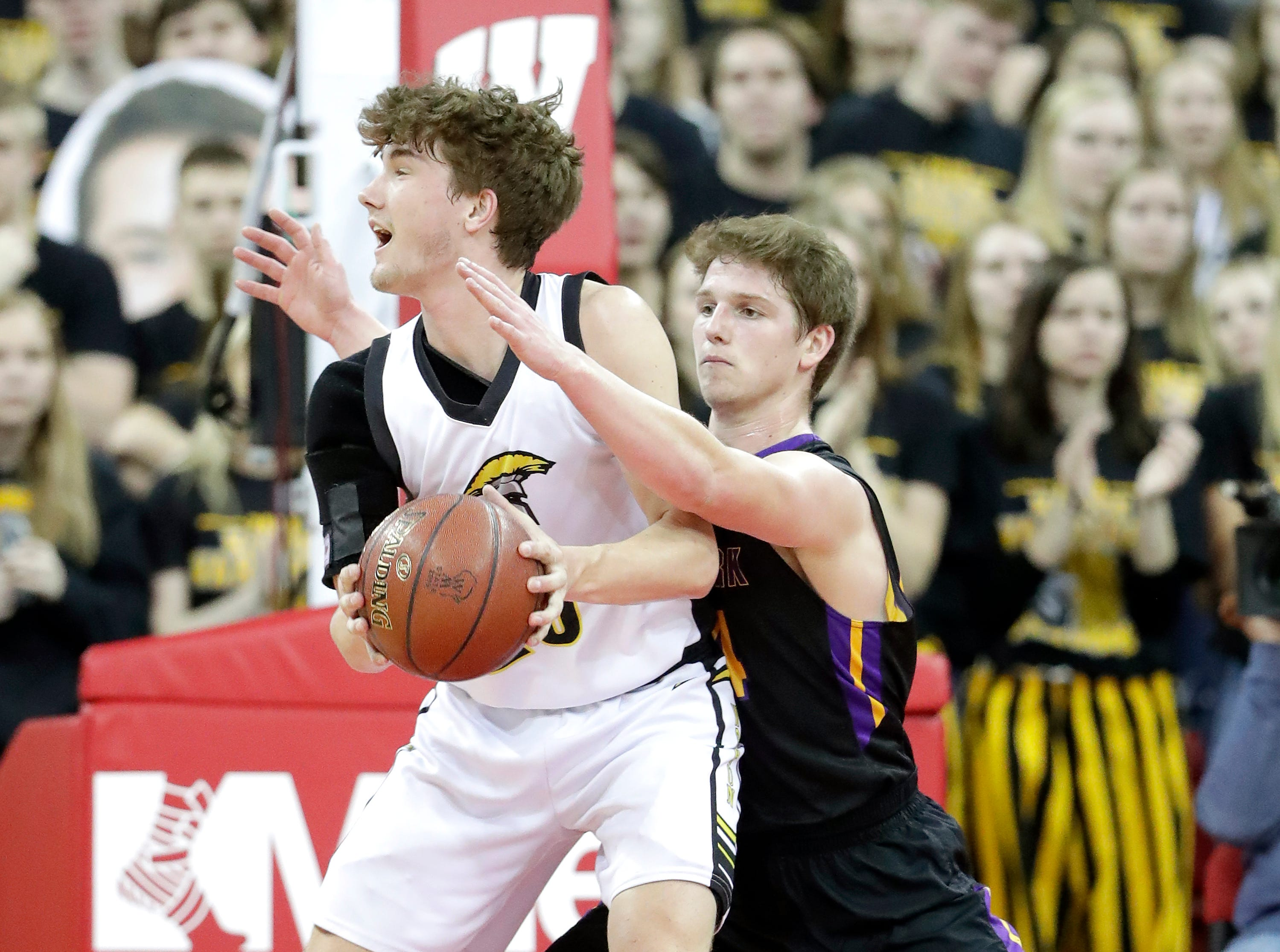 Denmark High School's #44 Jack Satori, back, against Waupun High Sch ool's #23 Reece Homanduring their WIAA Division 3 boys basketball state semifinal on Thursday, March 14, 2019, at the KohlCenter in Madison, Wis.