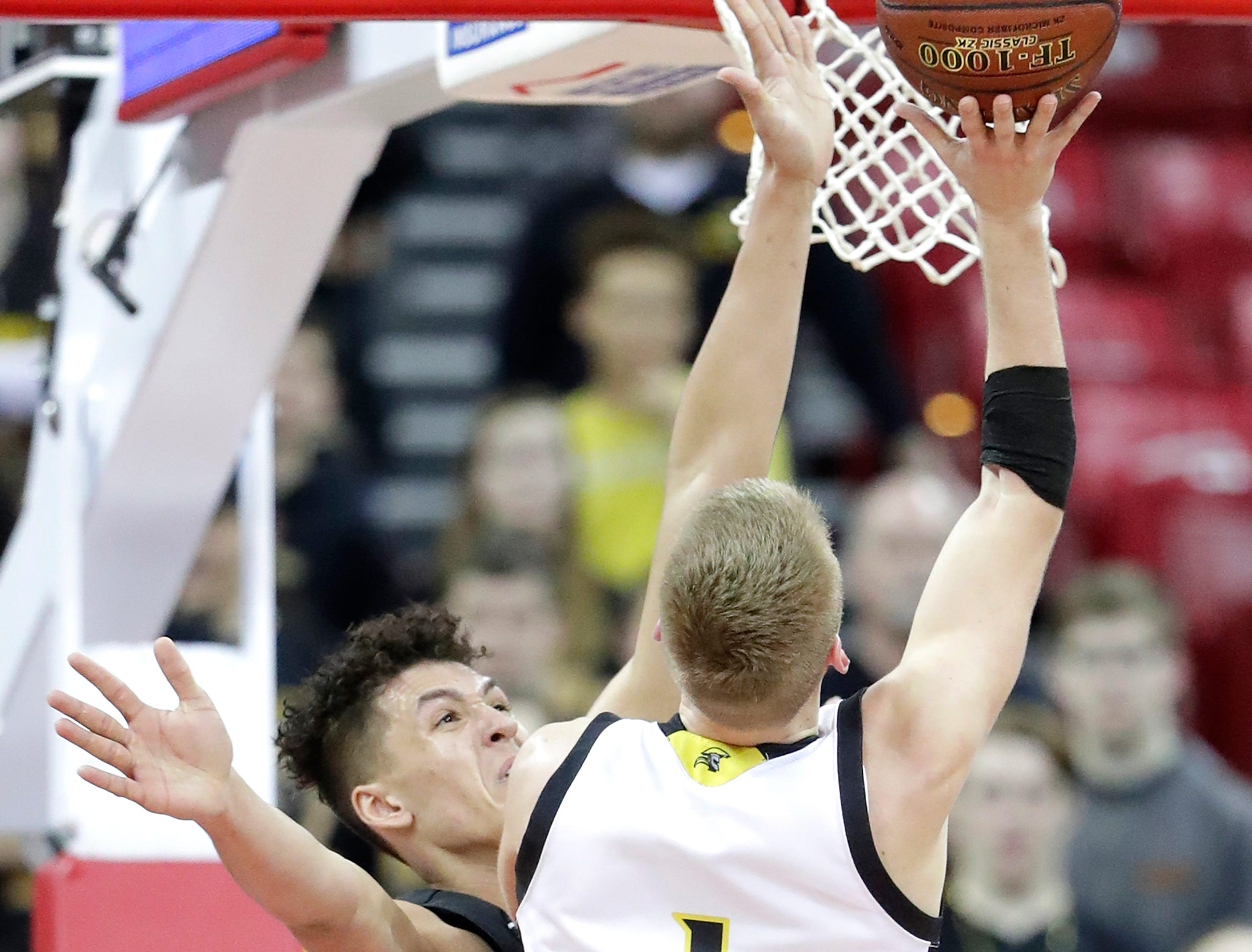 Denmark High School's #33 Patrick Suemnick against Waupun High School's #1 Marcus Domask during their WIAA Division 3 boys basketball state semifinal on Thursday, March 14, 2019, at the KohlCenter in Madison, Wis. Waupun defeated Denmark 60 to 43.
