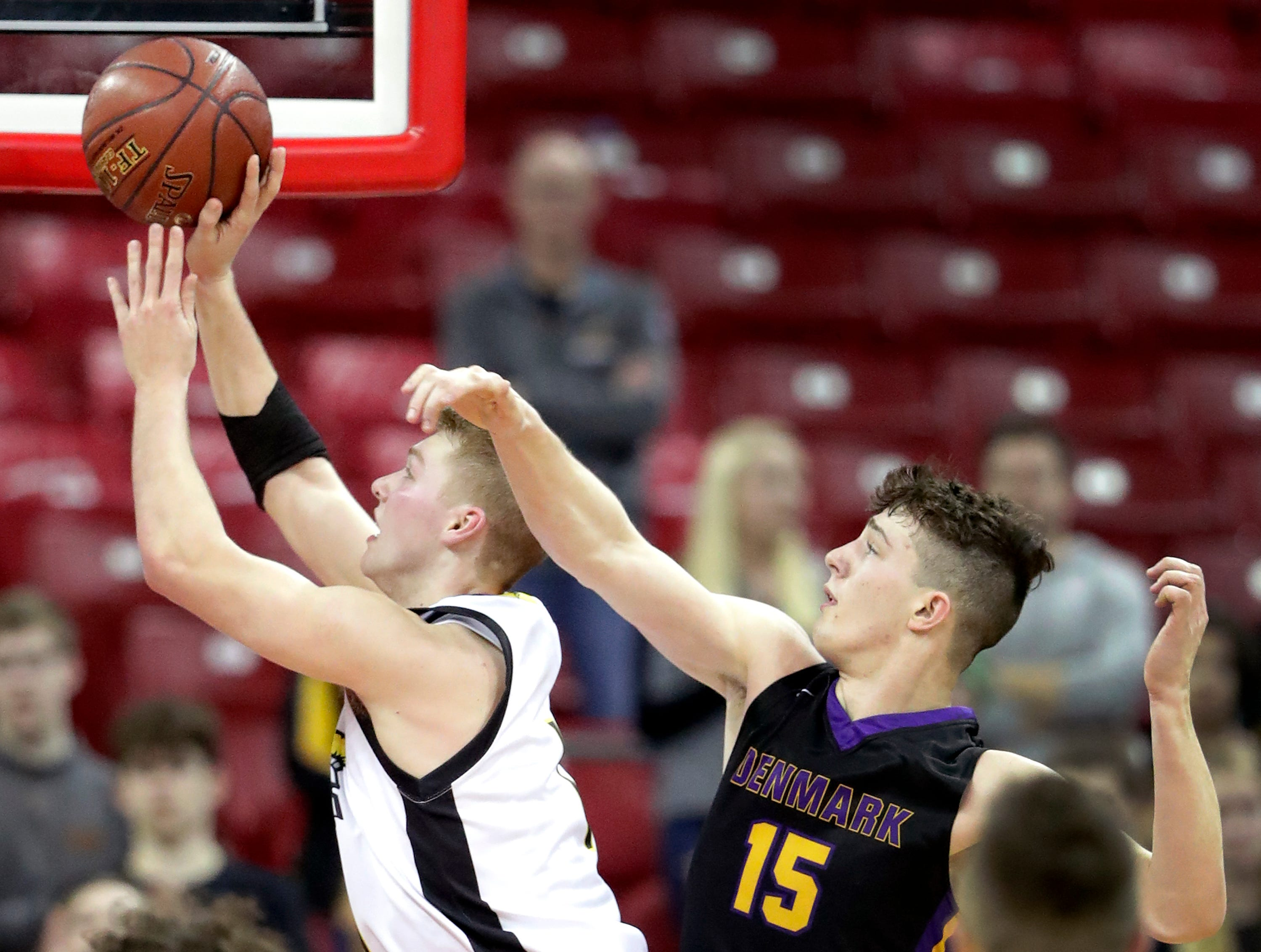 Denmark High School's #15 Zane Short against Waupun High School's #1 Marcus Domask during their WIAA Division 3 boys basketball state semifinal on Thursday, March 14, 2019, at the KohlCenter in Madison, Wis.  Waupun defeated Denmark 60 to 43.