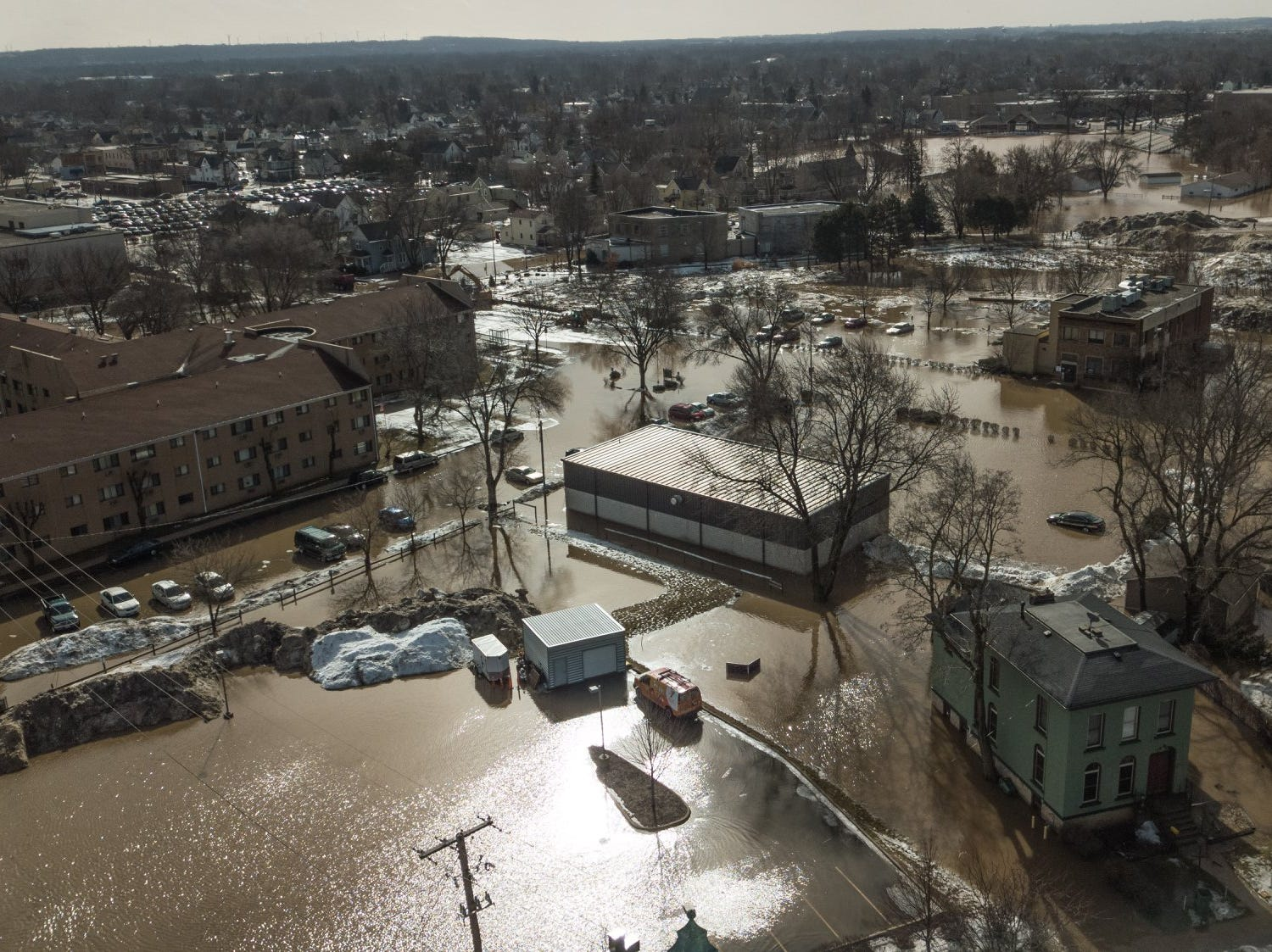 Ice jams caused water to spill over the shores of the Fond du Lac River on Thursday, March 14. Western Avenue west of the Fond du Lac County Sheriff's Office is pictured at around 11 a.m.