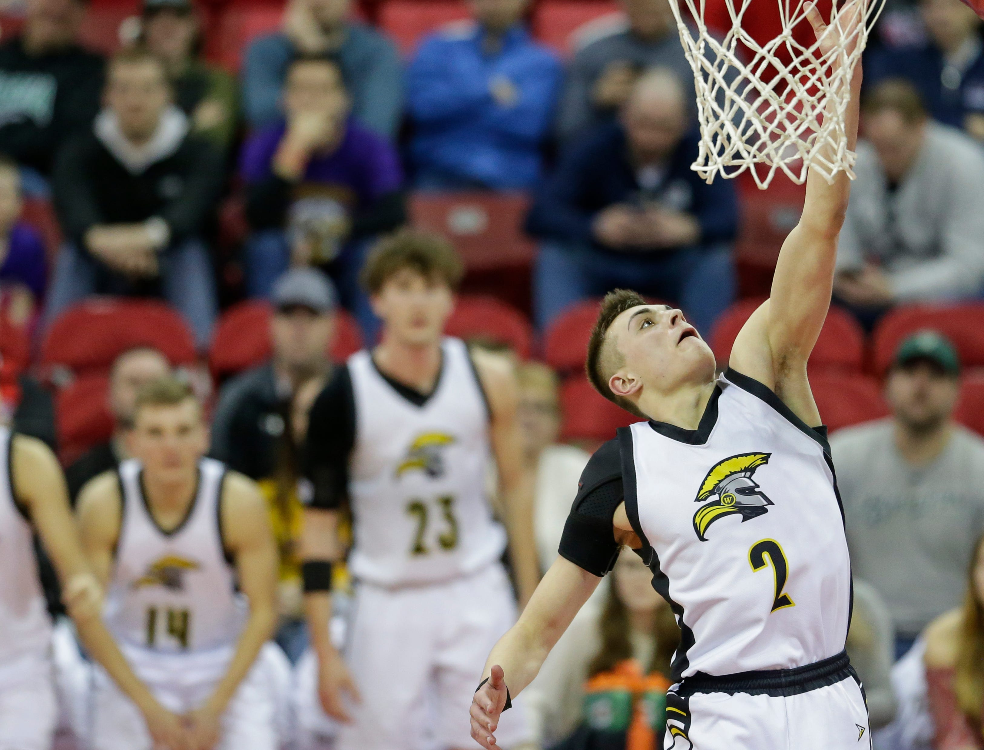 Waupun's Trevor VandeZande (2) goes to the rim for a layup against Denmark during their WIAA Division 3 boys basketball state semifinal at the Kohl Center Thursday, March 14, 2019, in Madison, Wis.
