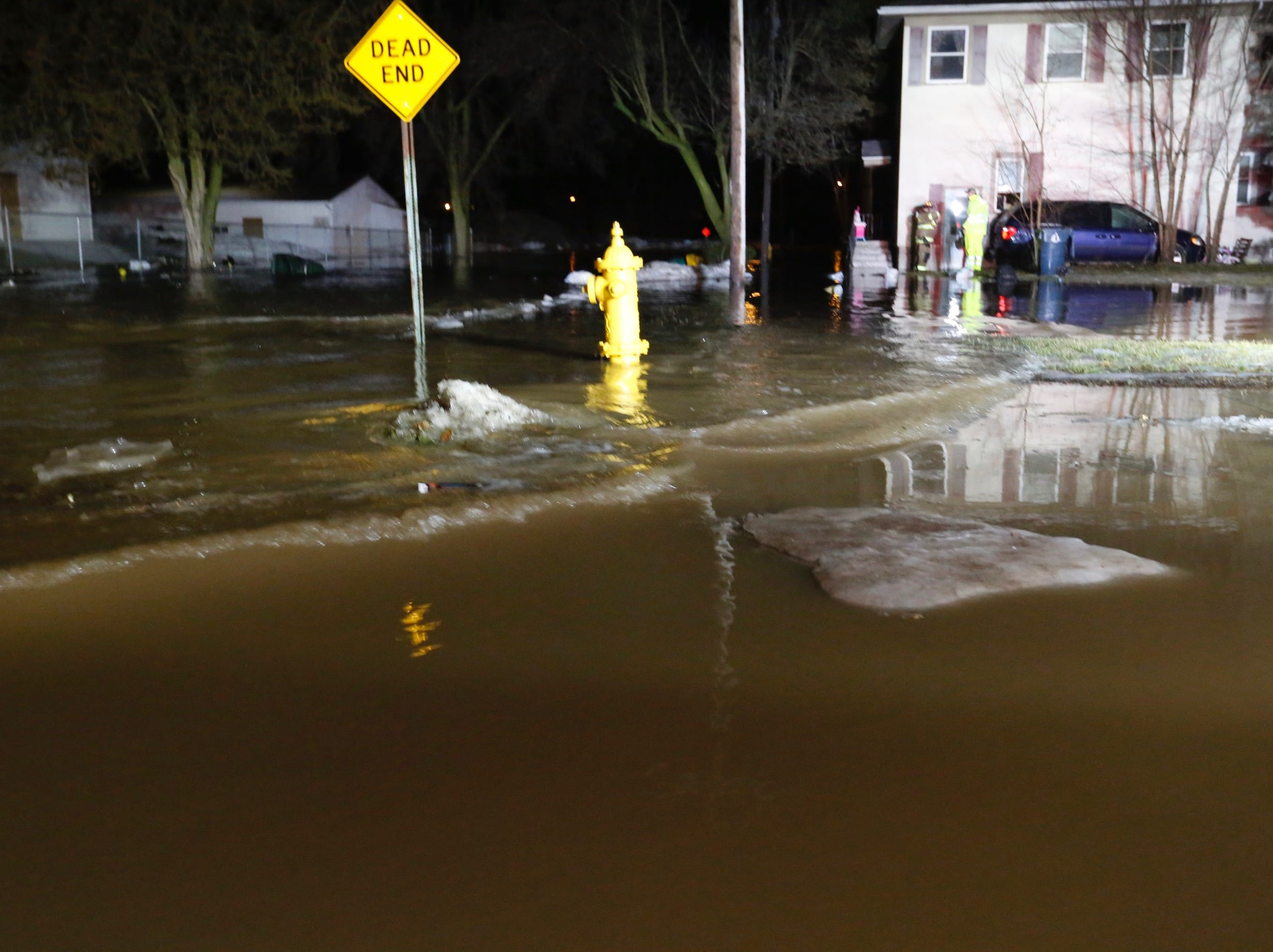 Firefighters assess flooding at a dead end on South Street