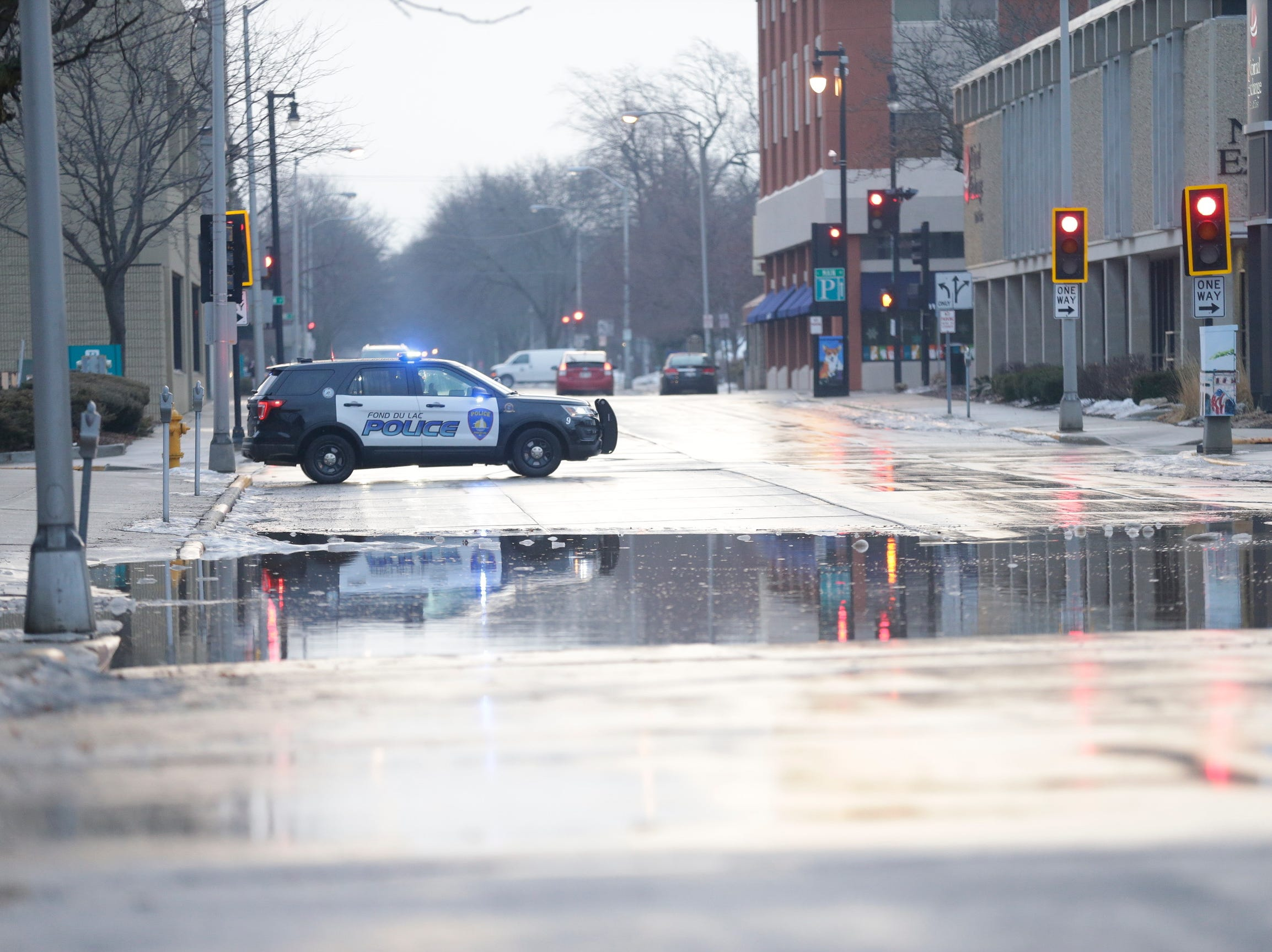 City of Fond du Lac police car blocks traffic on Second Street as water starts rising up due to an ice jam in the river.