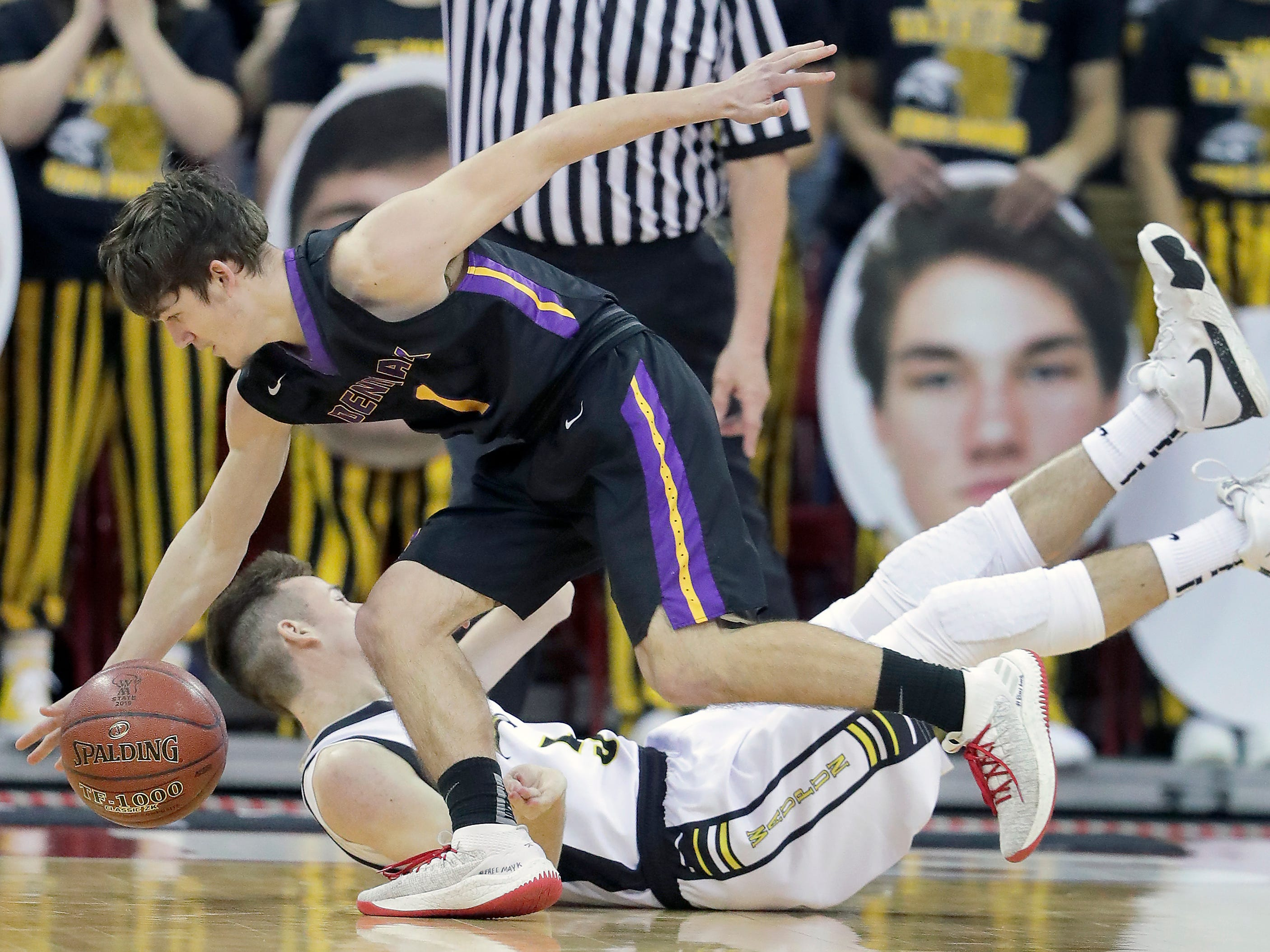 Denmark High School's #1 Seth Alexander against Waupun High School's #5 Alec Cunningham during their WIAA Division 3 boys basketball state semifinal on Thursday, March 14, 2019, at the KohlCenter in Madison, Wis.  Waupun defeated Denmark 60 to 43.