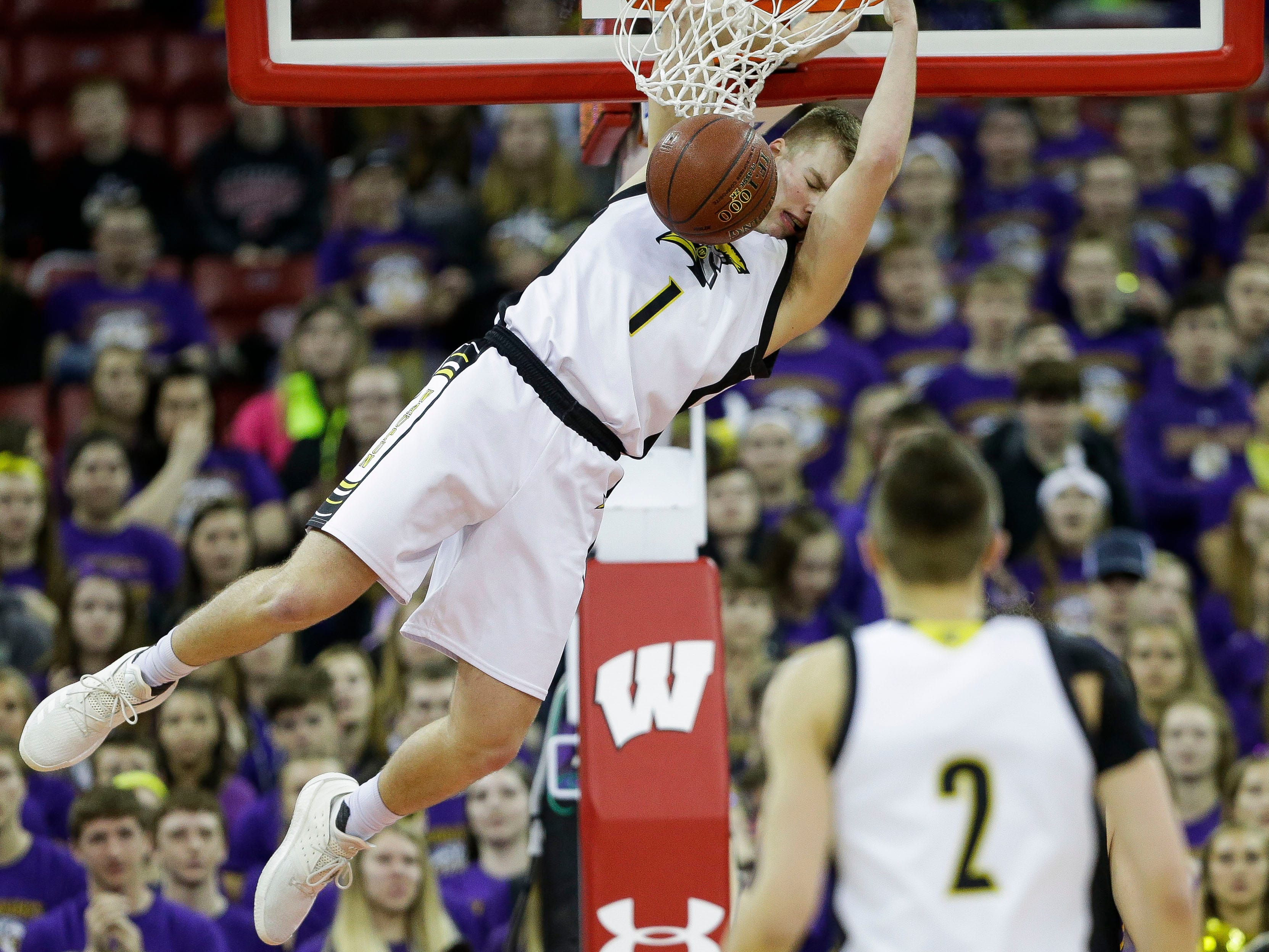 Waupun High School's Marcus Domask (1) dunks the ball against Denmark High School in a Division 3 boys basketball state semifinal on Thursday, March 14, 2019, at the Kohl Center in Madison, Wis.