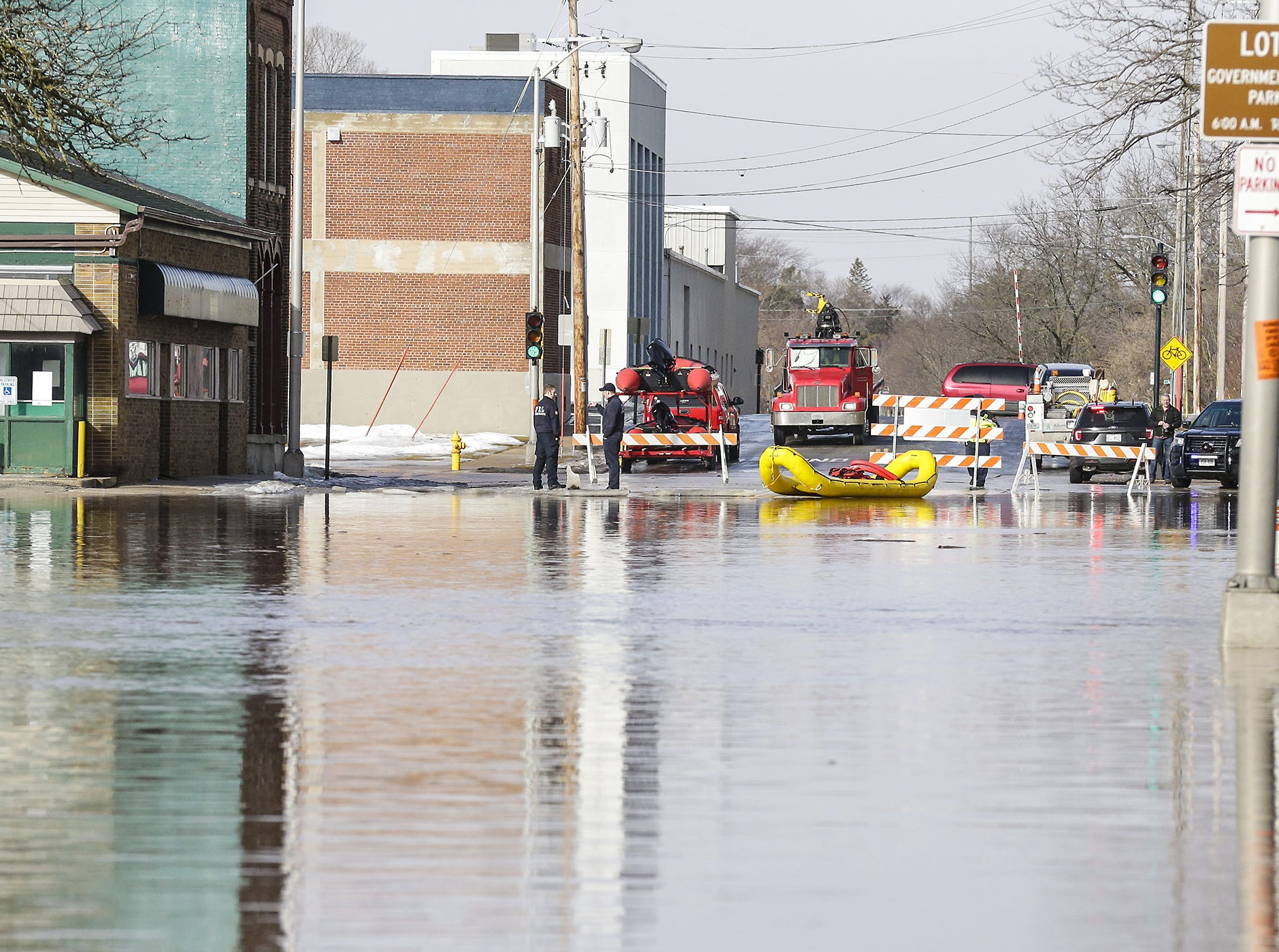 Fond du Lac Fire/Rescue members stand by with rafts Thursday, March 14, 2019 at the intersection of Military and Western in Fond du Lac, Wis. Ice jams on the east branch of the Fond du Lac River caused localized flooding problems in the city. Doug Raflik/USA TODAY NETWORK-Wisconsin