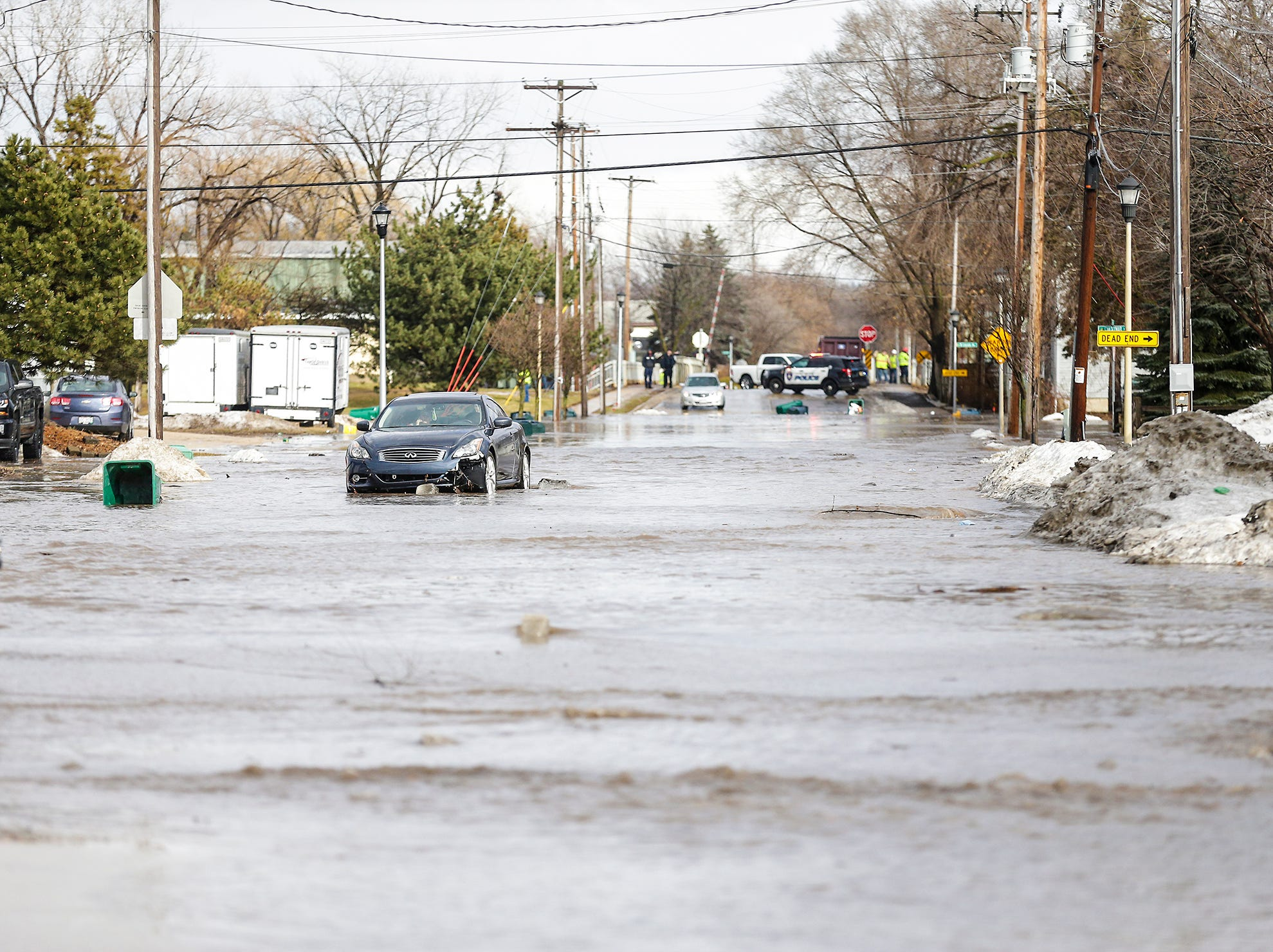 A car is stalled in high water Thursday, March 14, 2019 on West Arndt Street in Fond du Lac, Wisconsin. Ice jams on the east branch of the Fond du Lac River and heavy rainfall caused flooding problems throughout the city.
