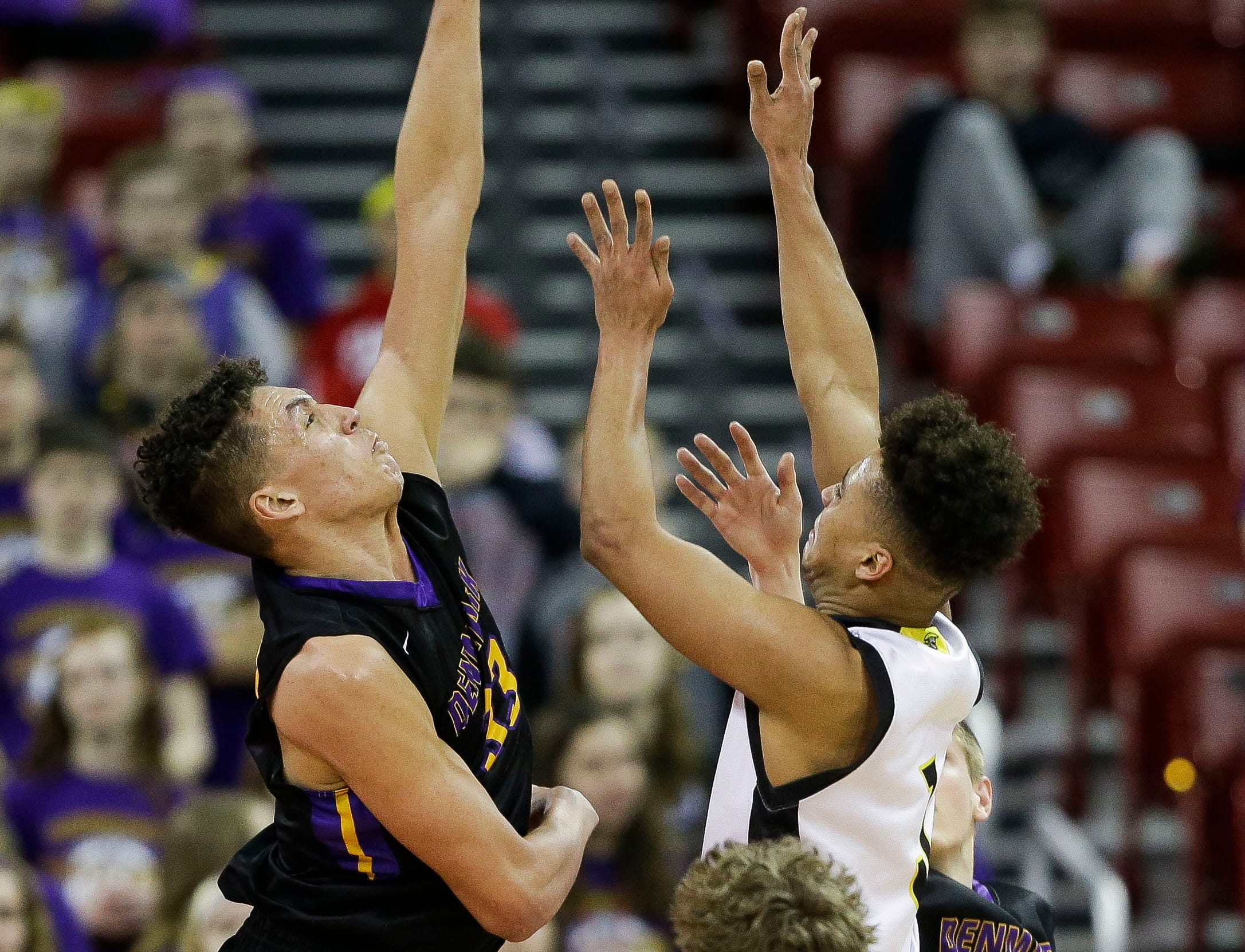 Denmark High School's Patrick Suemnick (33) blocks a shot by Waupun High School's Quintin Winterfeldt (3) in a Division 3 boys basketball state semifinal on Thursday, March 14, 2019, at the Kohl Center in Madison, Wis.
