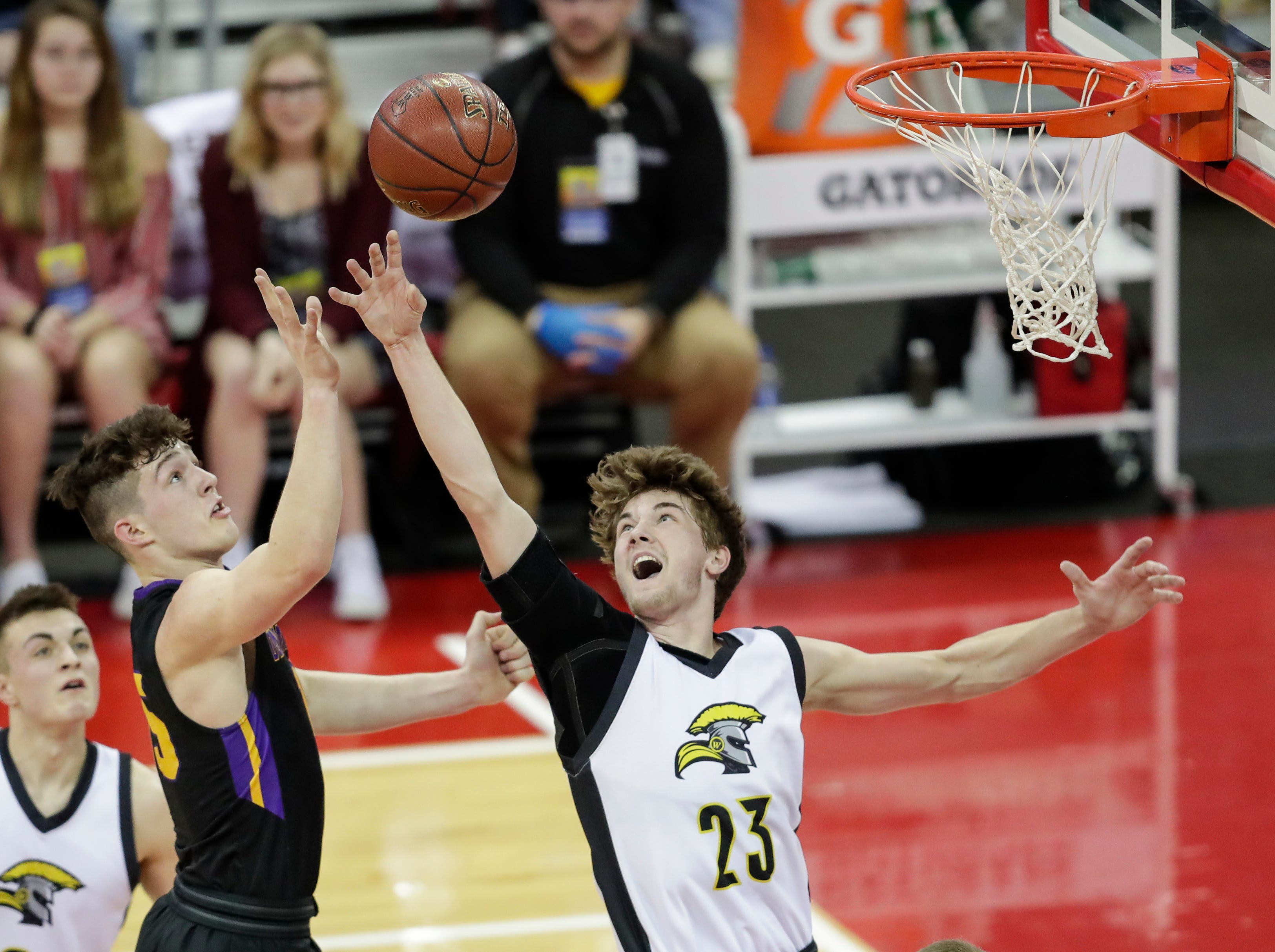 Denmark High School's Zane Short (15) puts up a shot over Waupun High School's Reece Homan (23) during their WIAA Division 3 boys basketball state semifinal at the Kohl Center Thursday, March 14, 2019, in Madison, Wis.