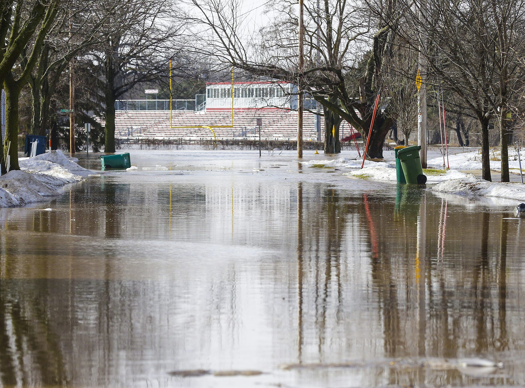 Fruth Field can be seen in the background Thursday, March 14, 2019 of a flooded Oak Street in Fond du Lac, Wis. Ice jams on the east branch of the Fond du Lac River caused localized flooding problems in the city. Doug Raflik/USA TODAY NETWORK-Wisconsin